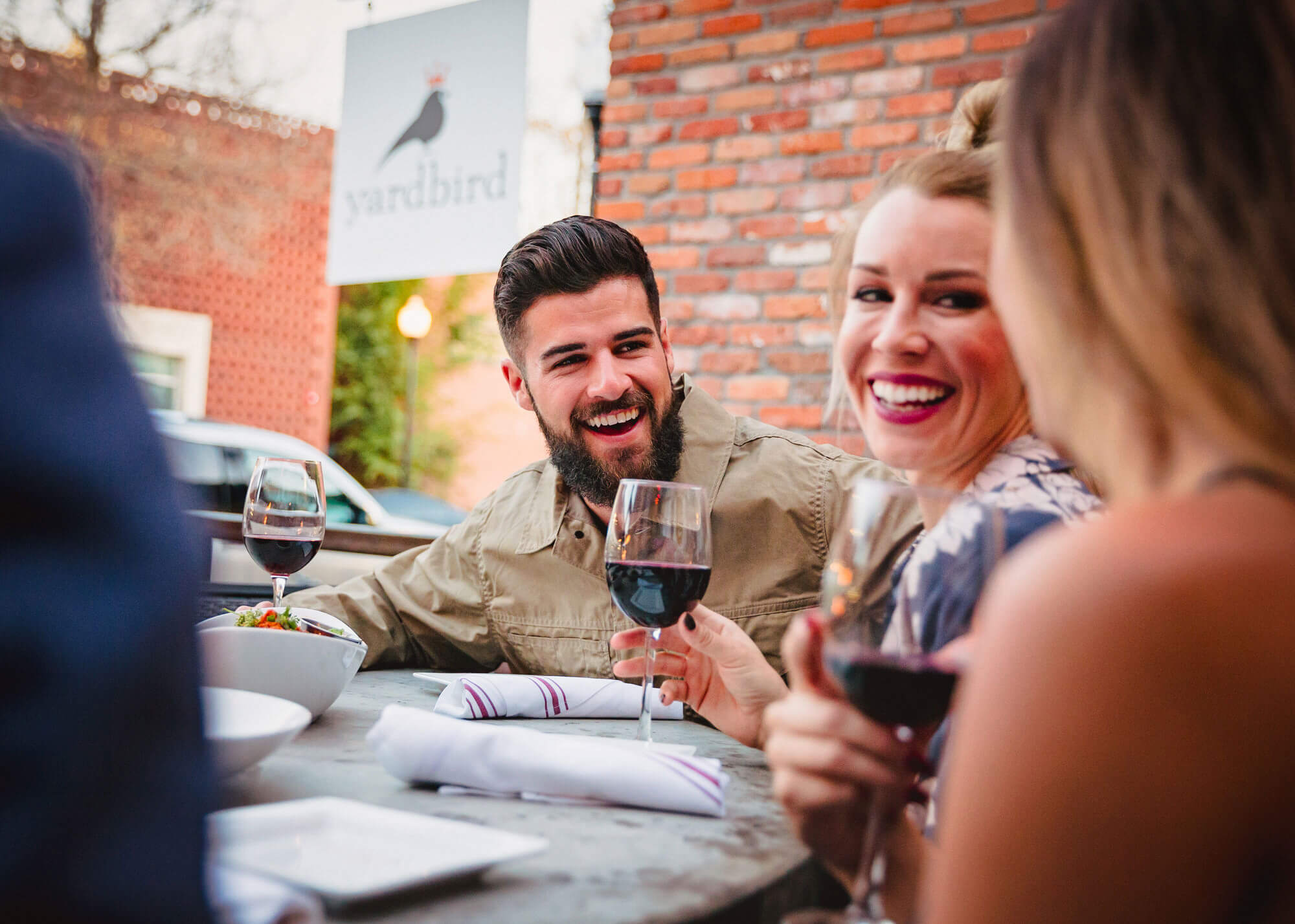 Friends with wine glasses on restaurant patio