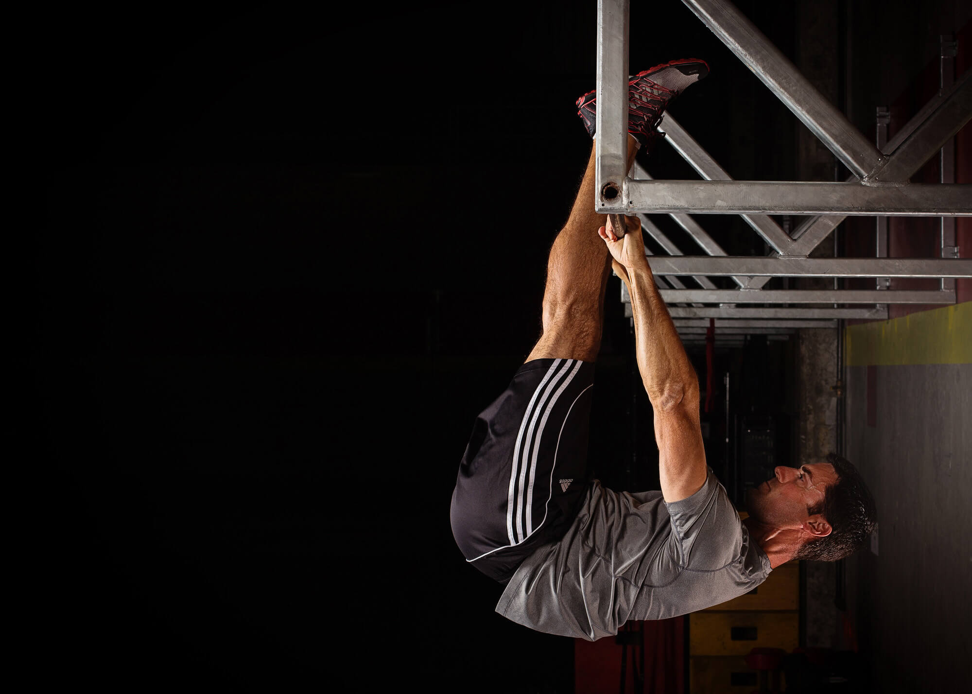 Athlete hanging from workout bar