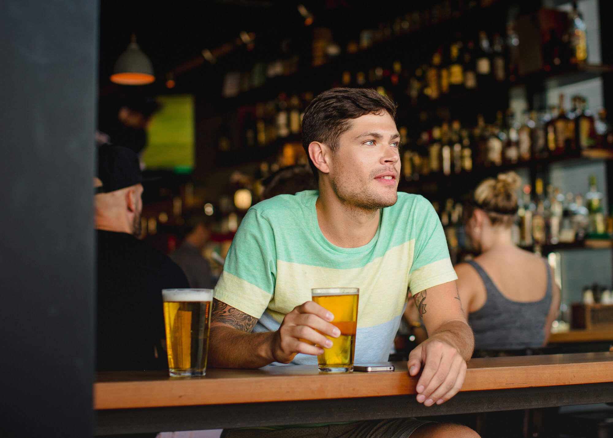 Man with beer on restaurant patio