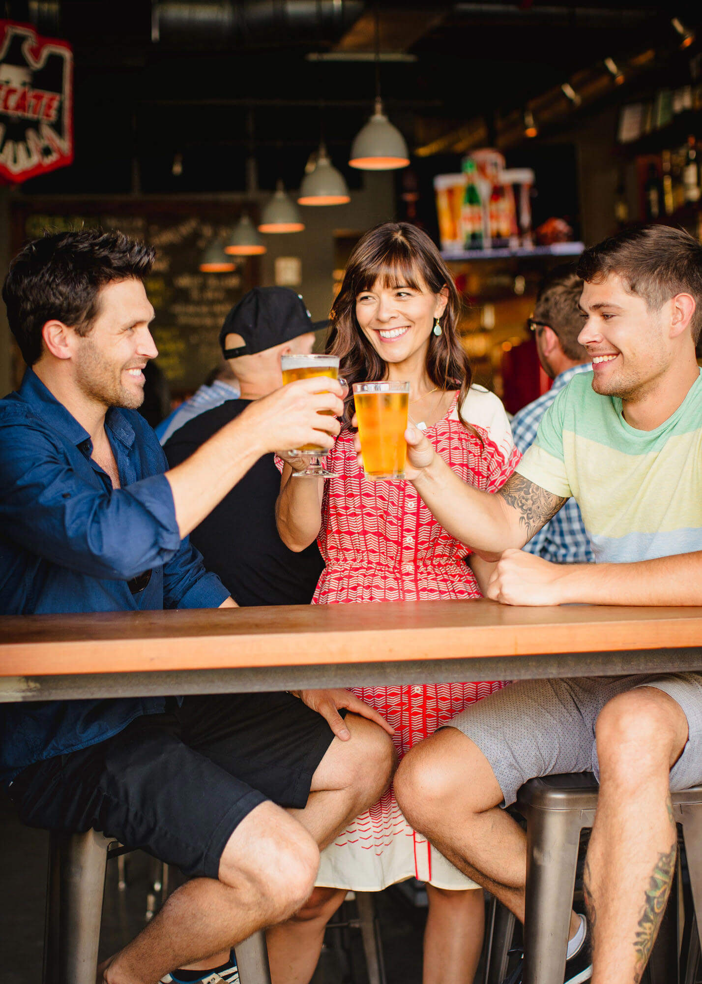 Friends with beers at restaurant
