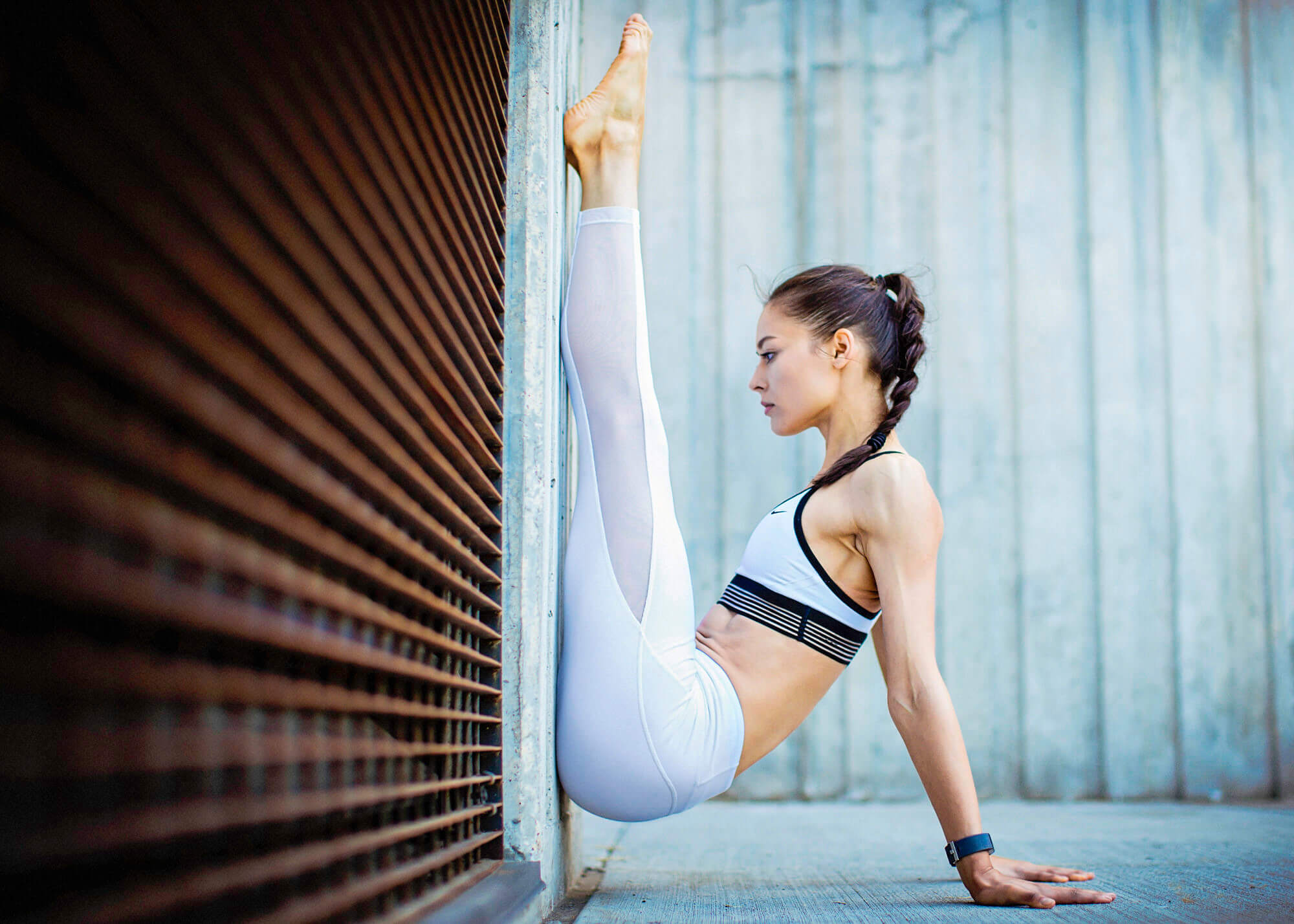Yoga and fitness model posing against wall