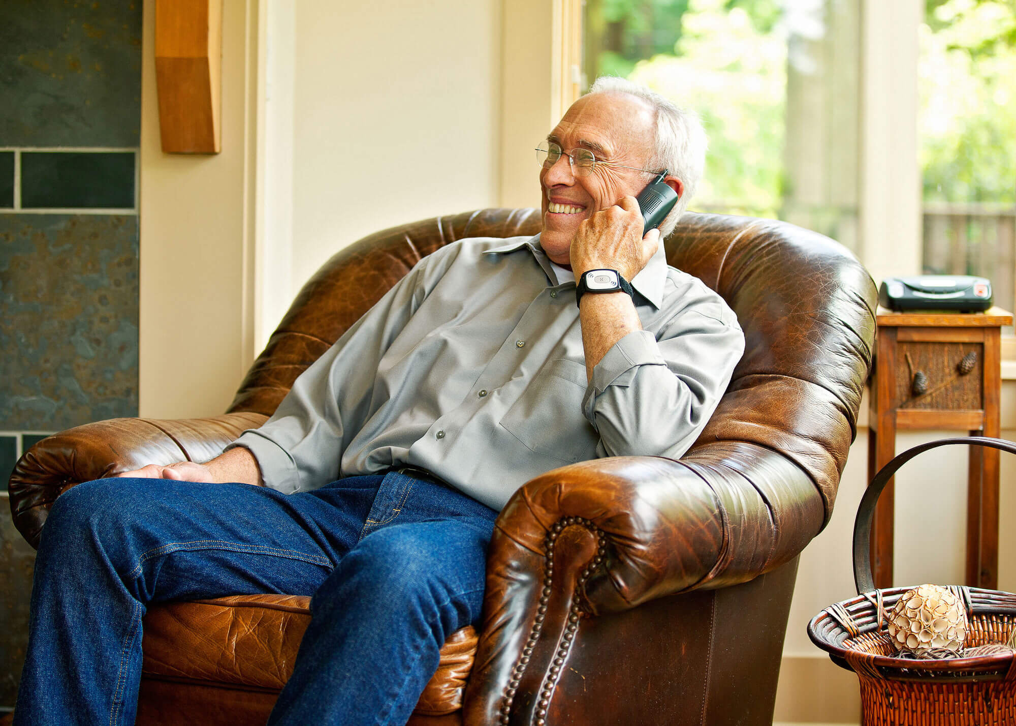 Man on phone in leather chair