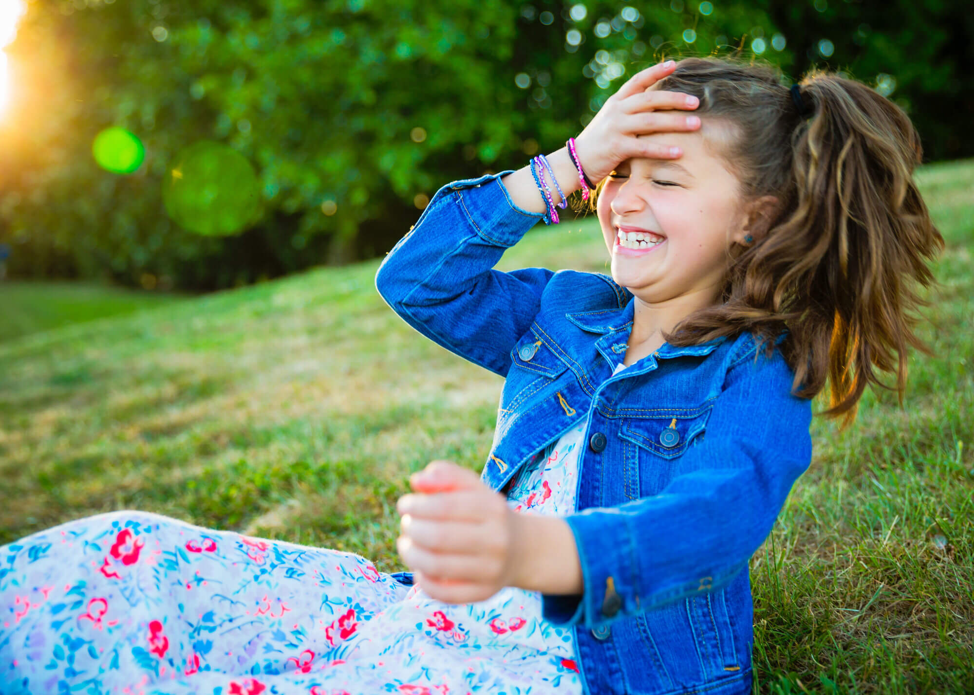 Child laughing in grass