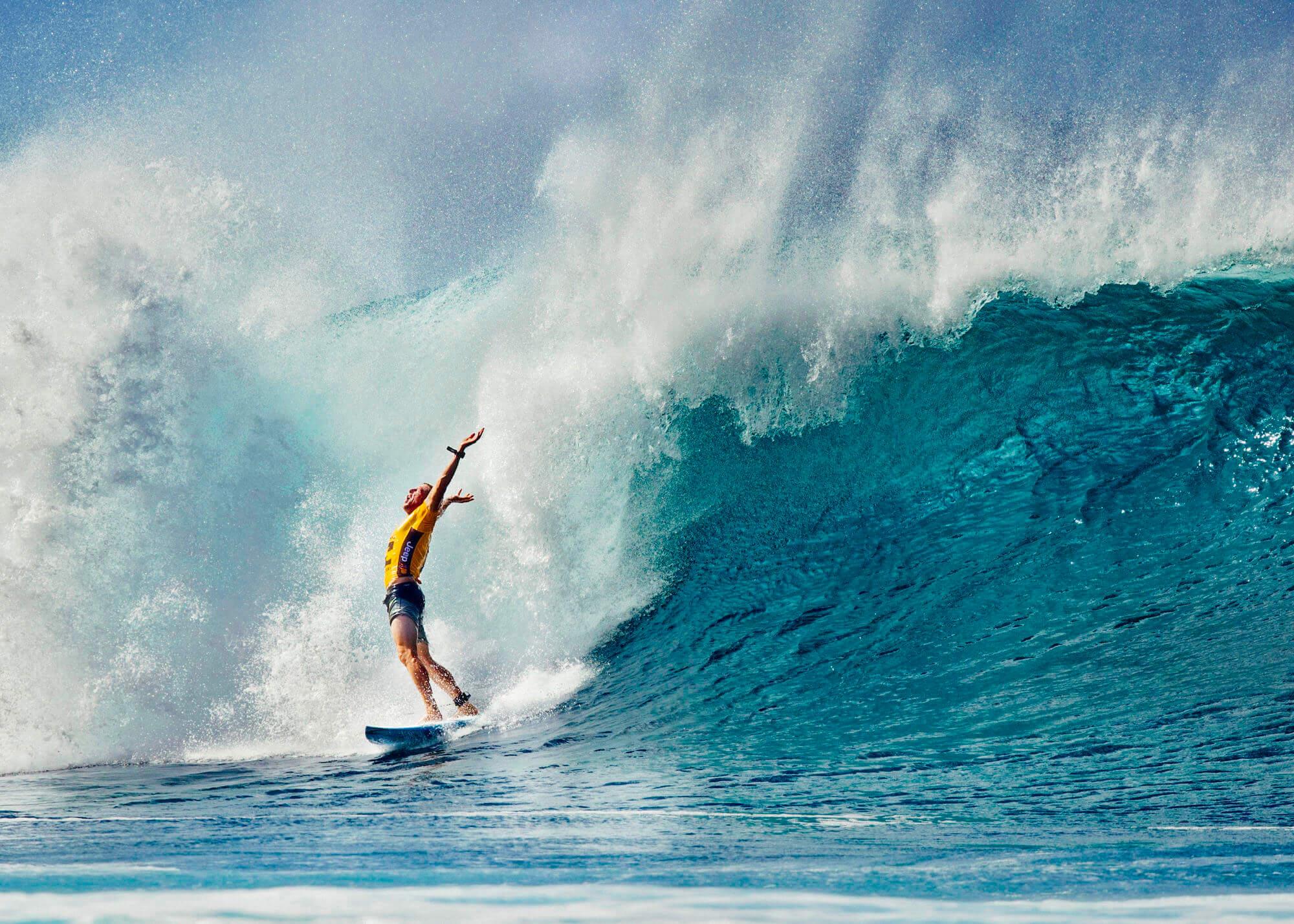 Man celebrating on surf board