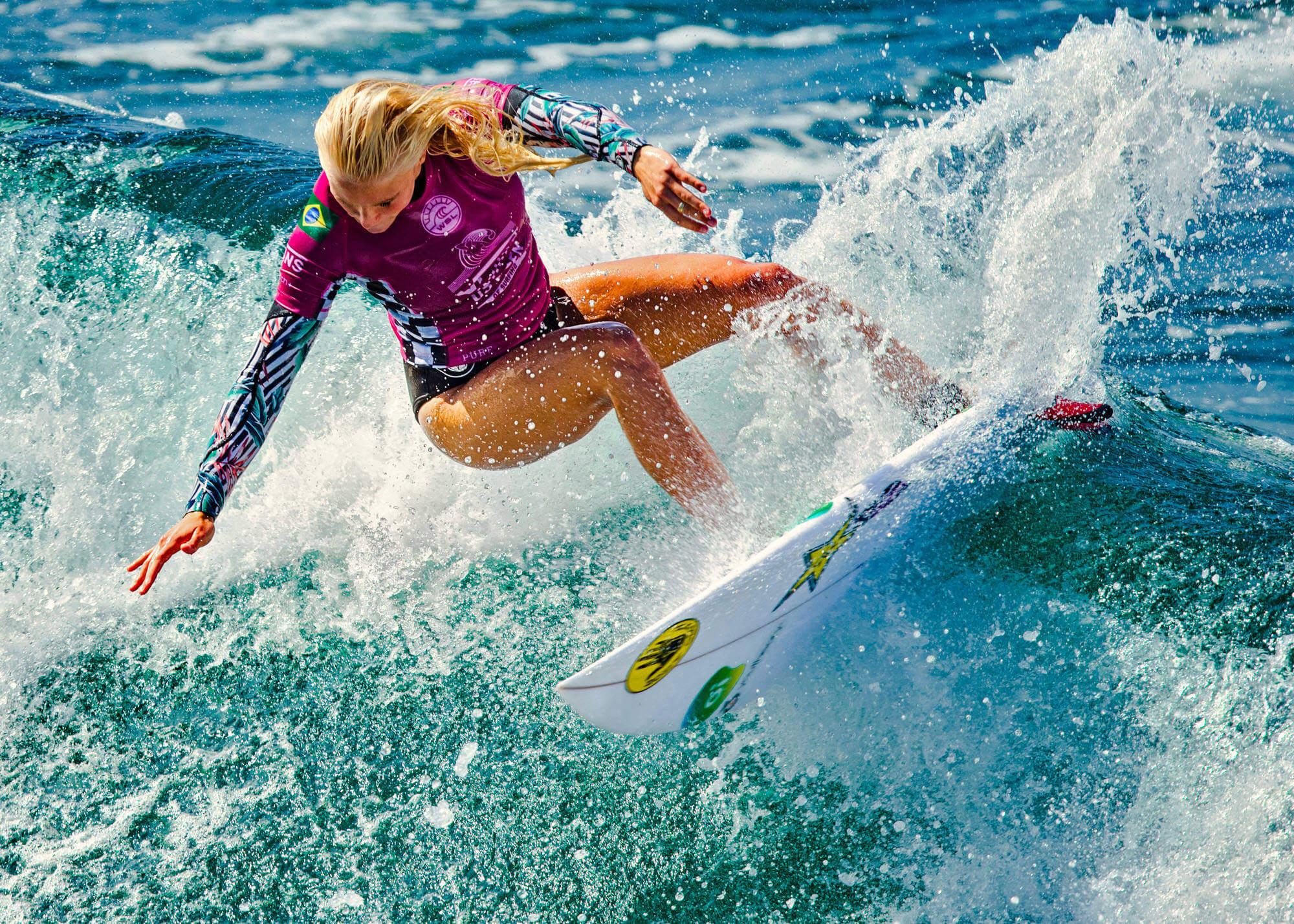 Woman turning on surfboard