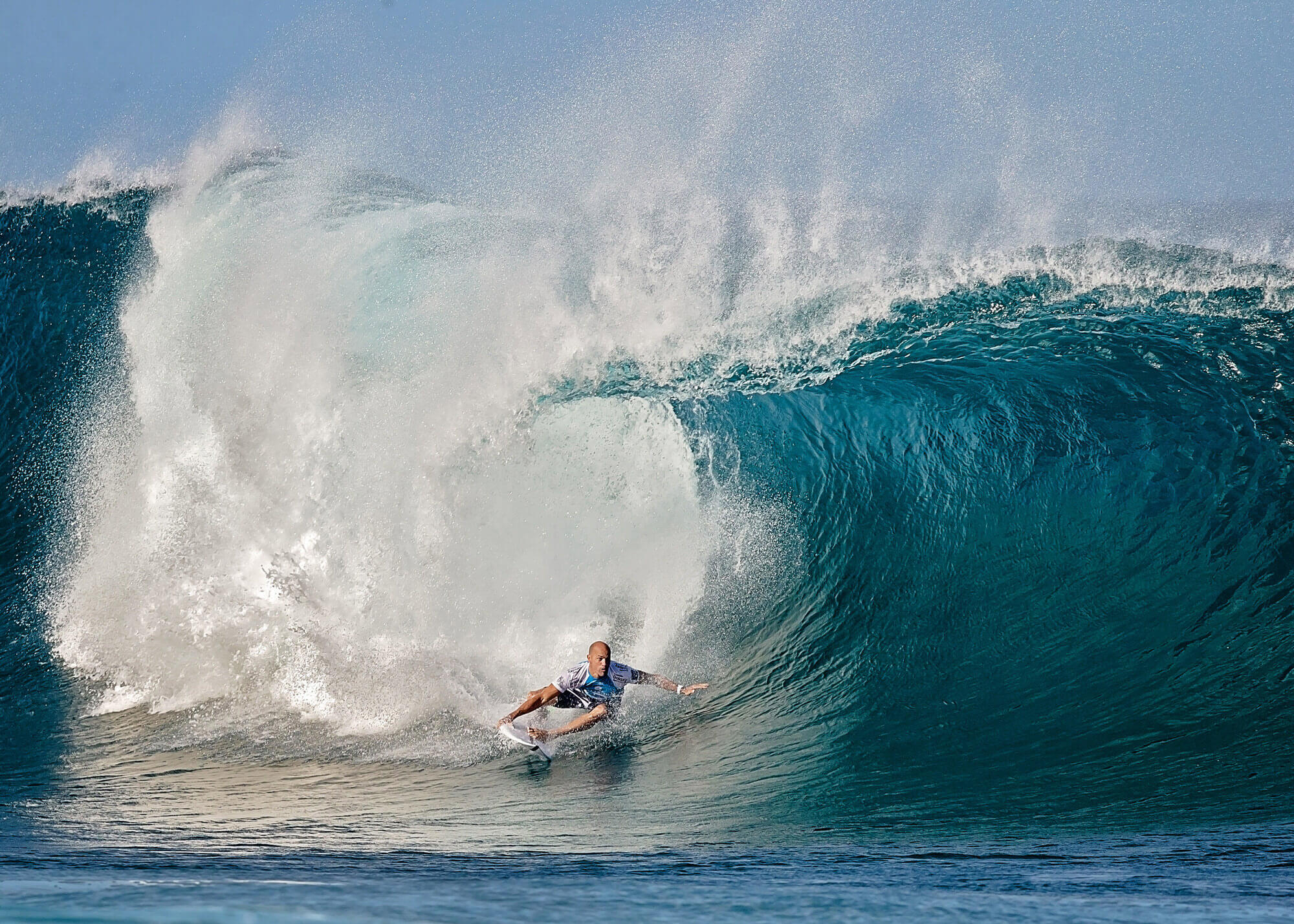 Man on surfboard on big wave