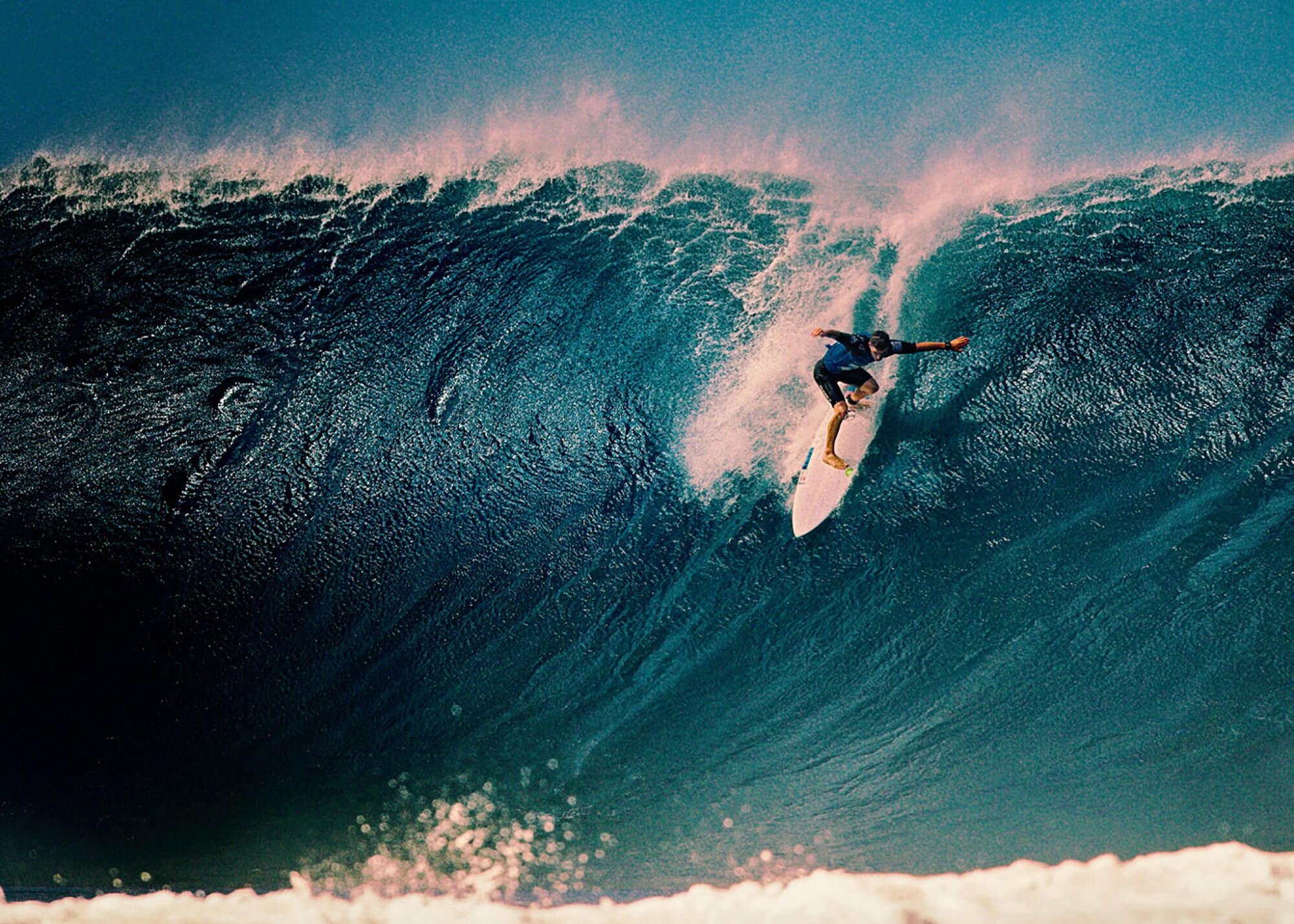 Man riding down big wave