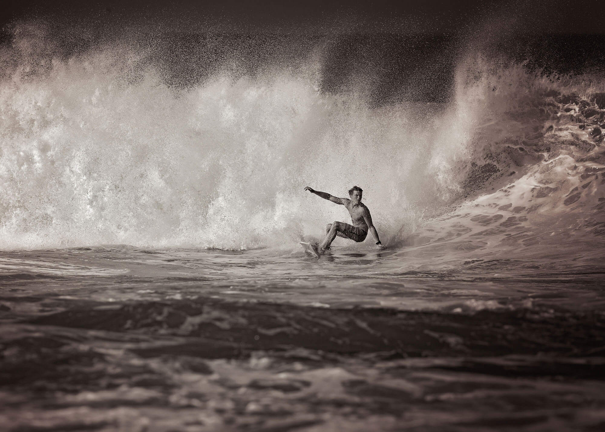 Man riding out of big wave