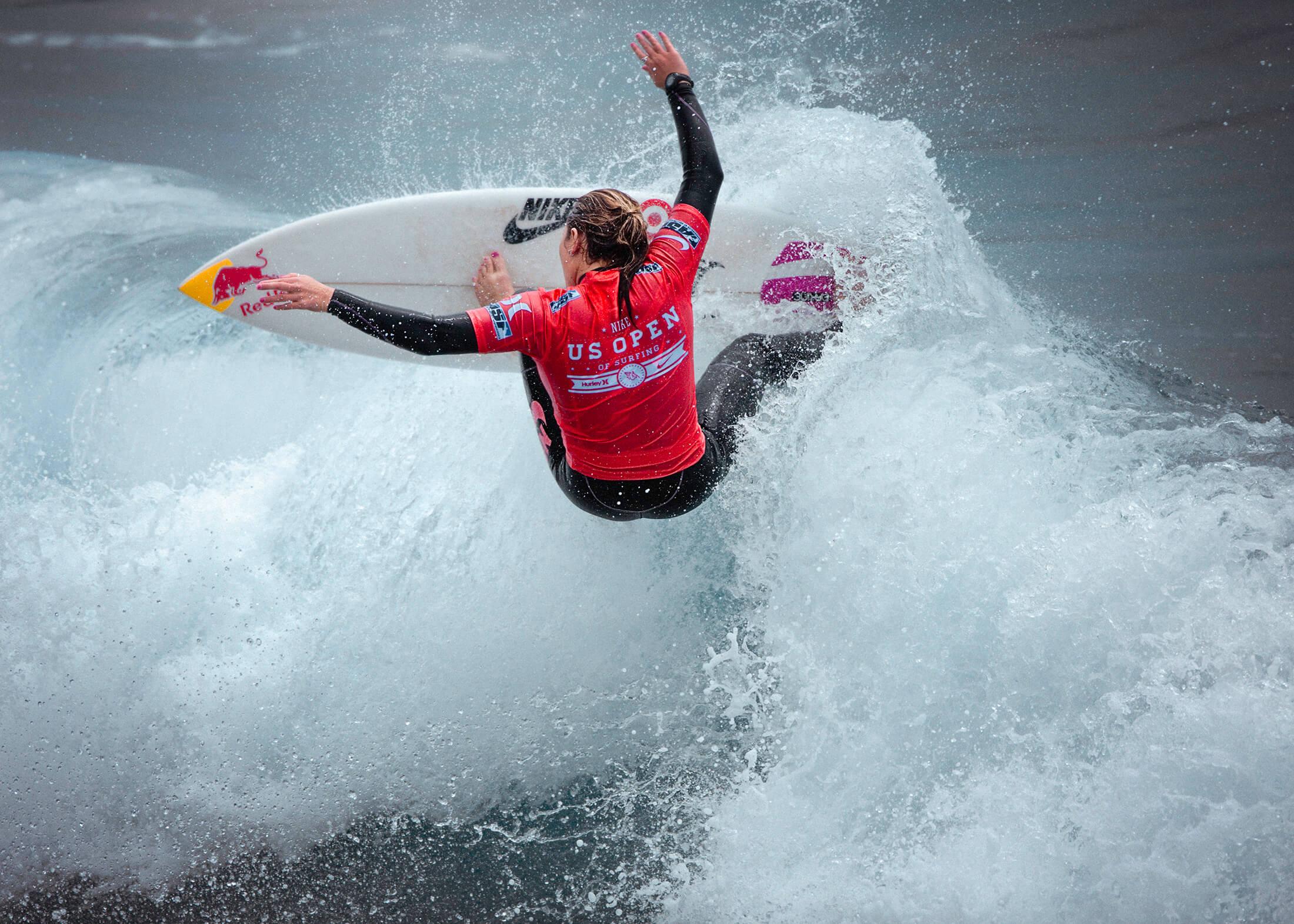Woman turning on surfboard