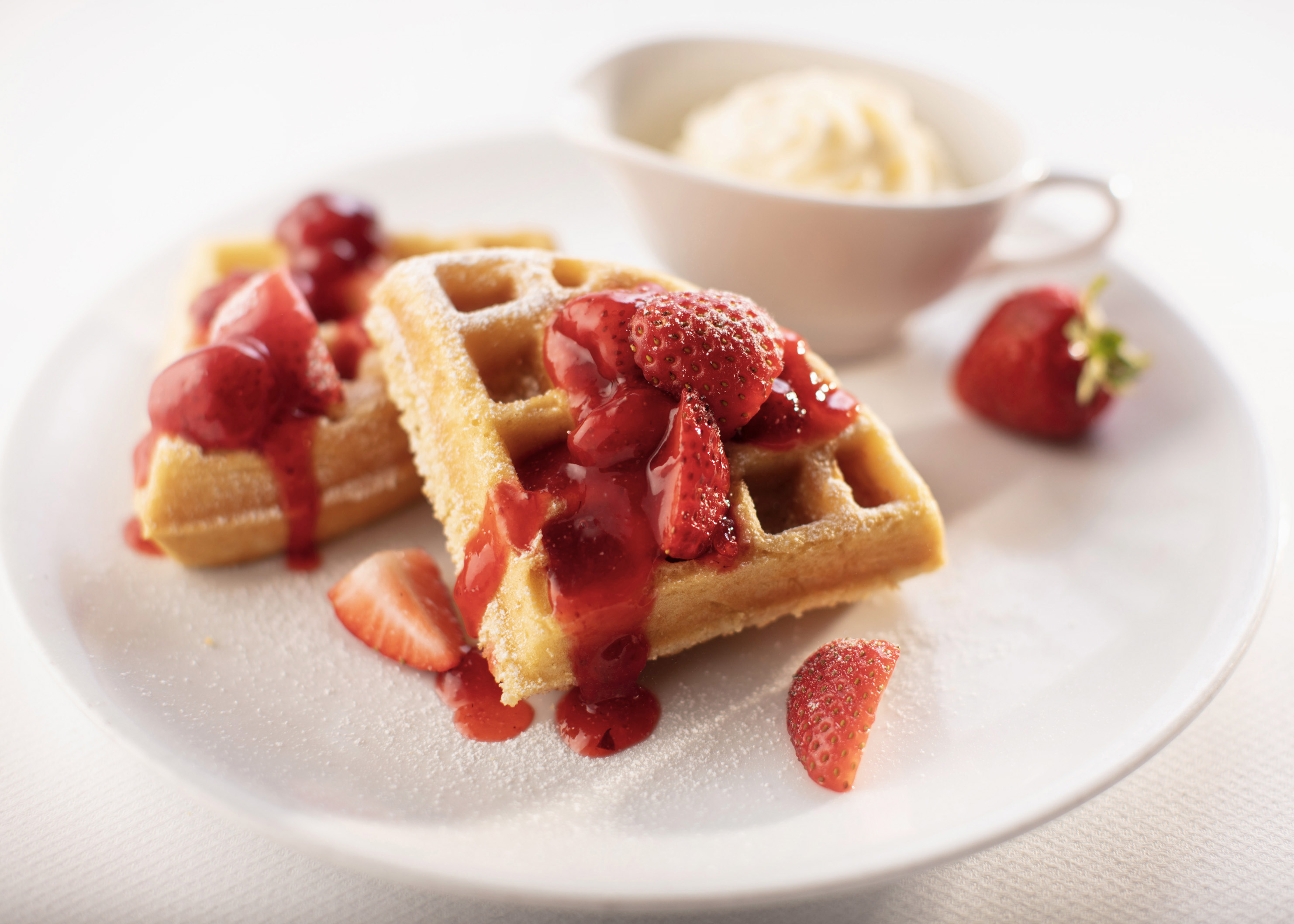 Plated waffles and strawberries