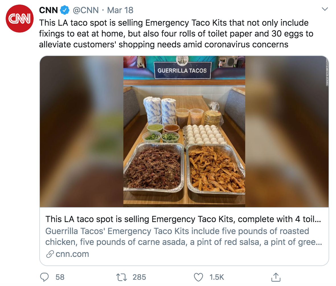 tweet reads: this LA taco spot is selling Emergency Taco Kits that not only include fixings to eat at home, but also four rolls or toilet paper and 30 eggs to alleviate customer' shopping needs amid coronavirus concerns. the image is of the offering: two large rectangle containers of beef and chicken, 30 eggs, bowls of green onions, jalapeños, avacaco dip, and salsa. There is also a bag of tortillas, two plastic cups of cheese and broth, and four rolls of toilet paper. This tweet has 58 comments, 285 retweets, and 1.5k likes