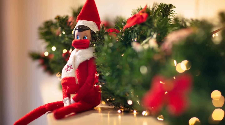 Elf on the Shelf with Christmas garland