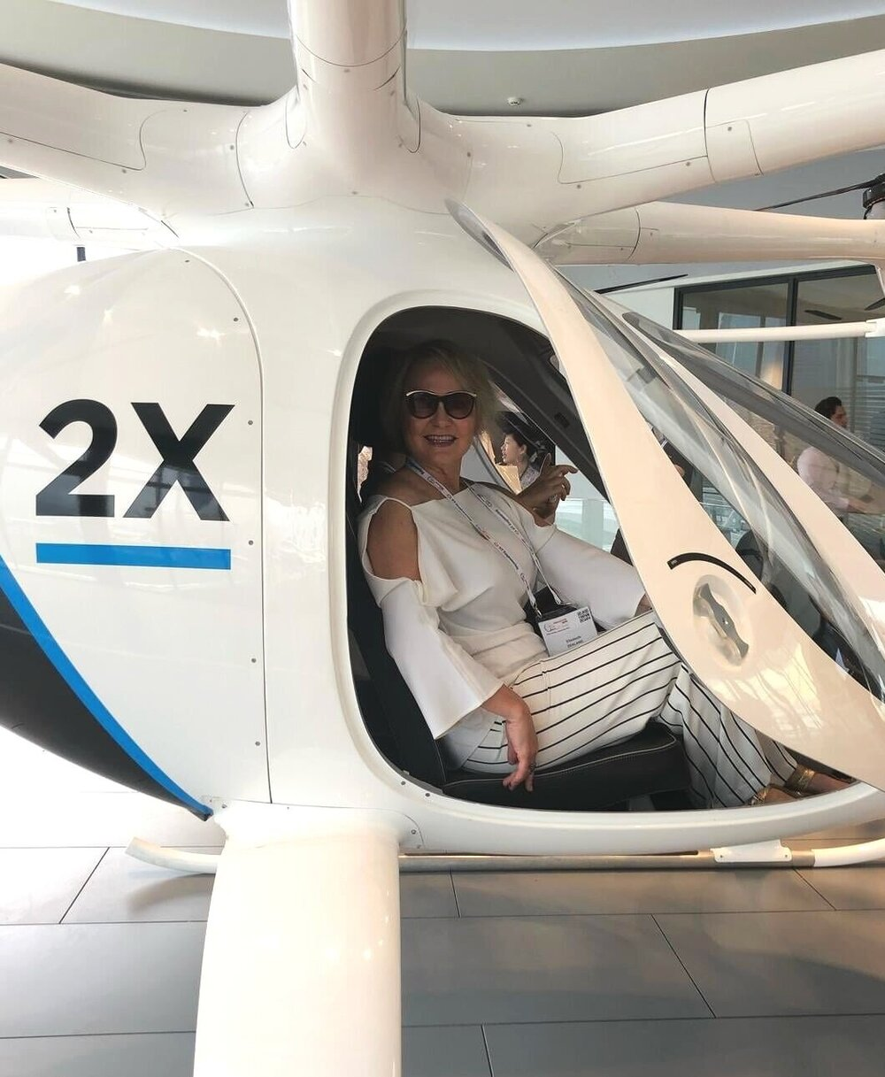 Spot Parking CEO Elizabeth Zealand inside the Volocopter, an electric air taxi that made its first public showcase over Marina Bay during the Congress