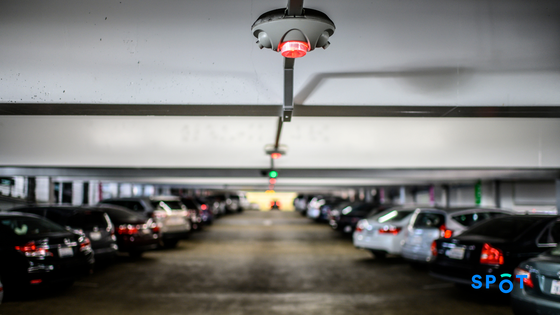 A parking sensor in a parking lot to help reduce the amount of time people spend looking for parking