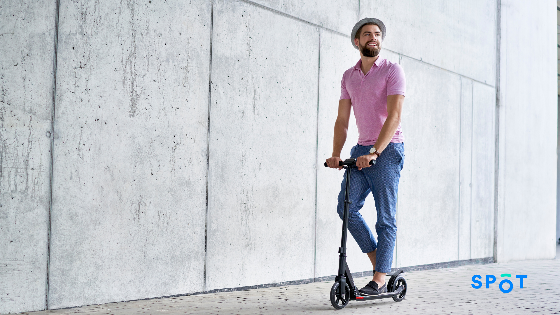 A person riding a scooter, micromobility can empower communities to move more sustainable