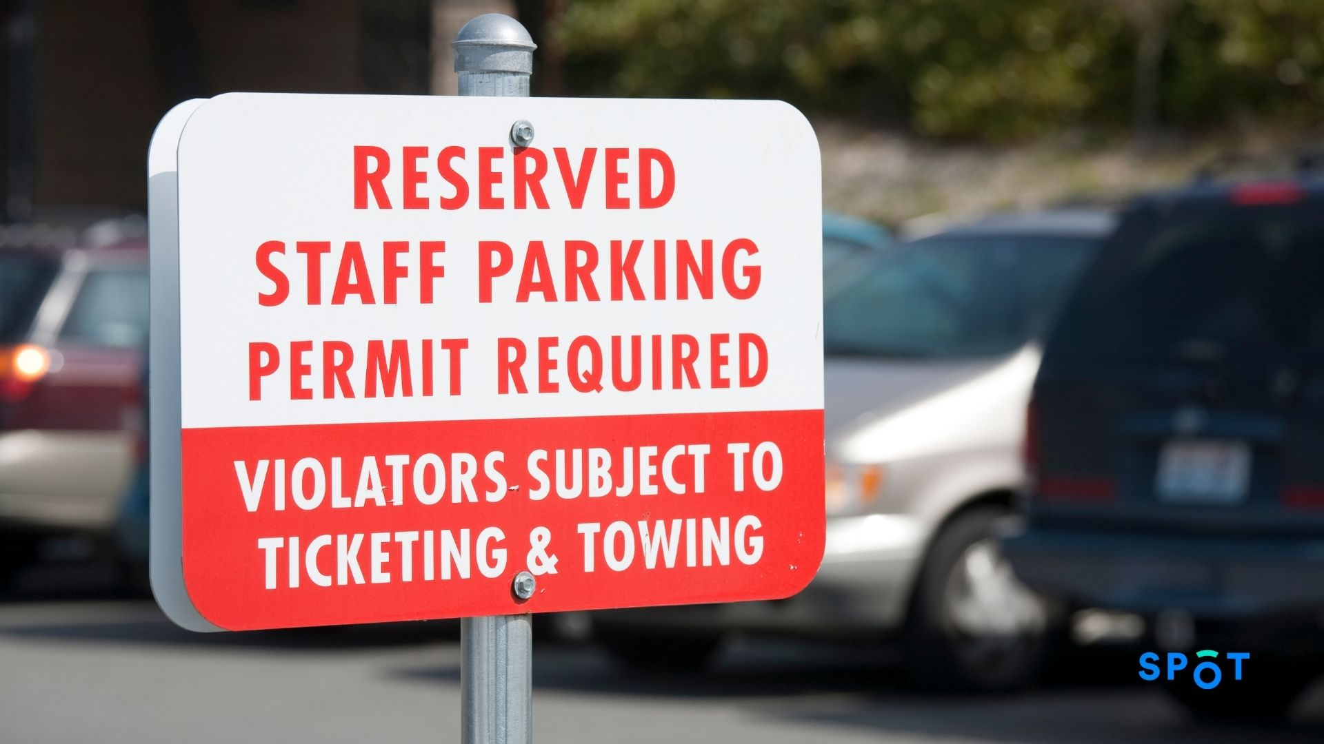 A reserved staff parking permit sign, parking permits in universities continue to be a headache