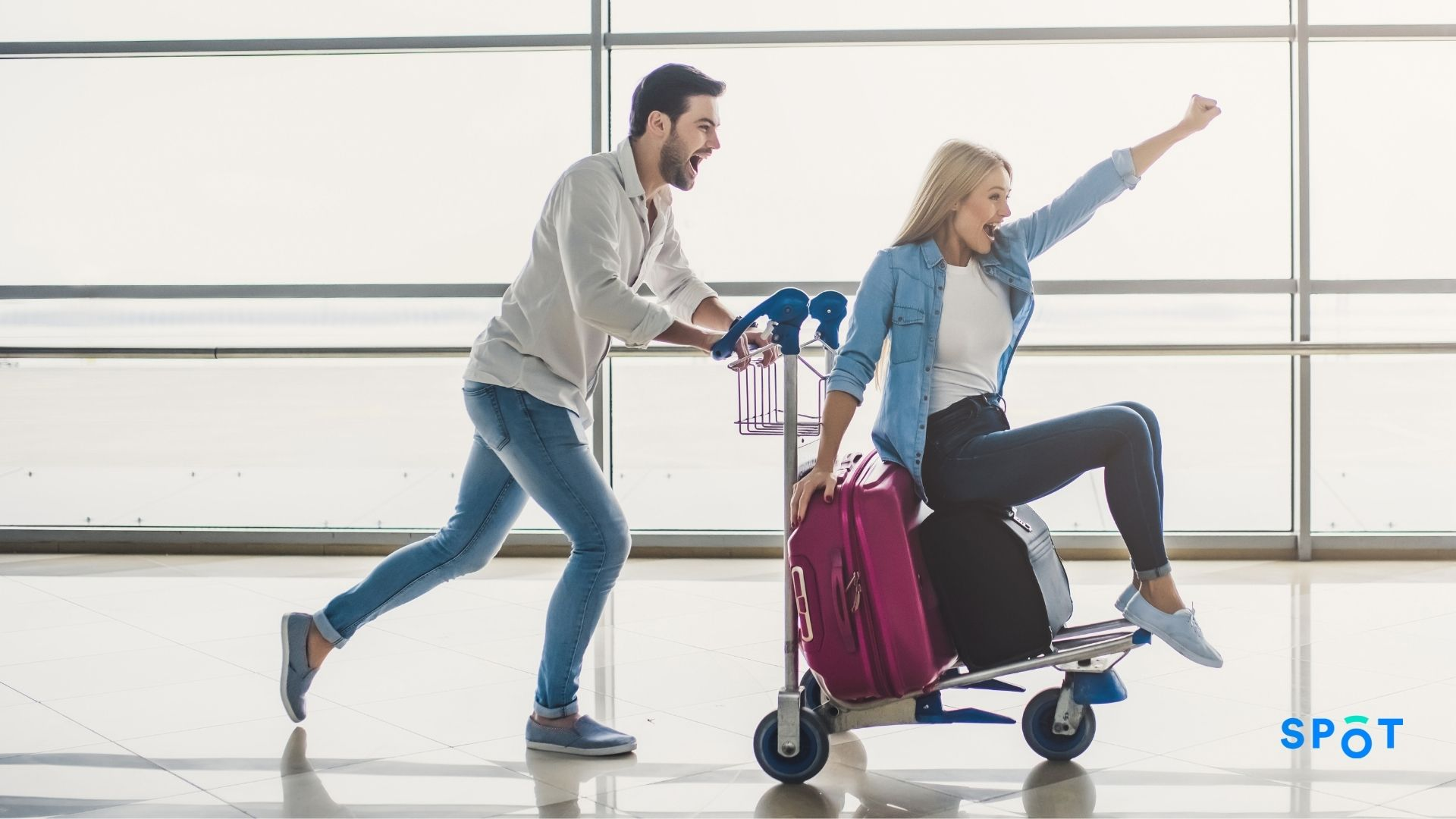 A couple having fun at the airport, how airports can enhance the traveling experience