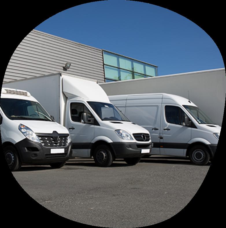 Several vans parked in a depot