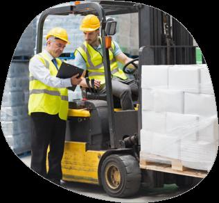 A supervisor explaining safety documentation to a forklift driver