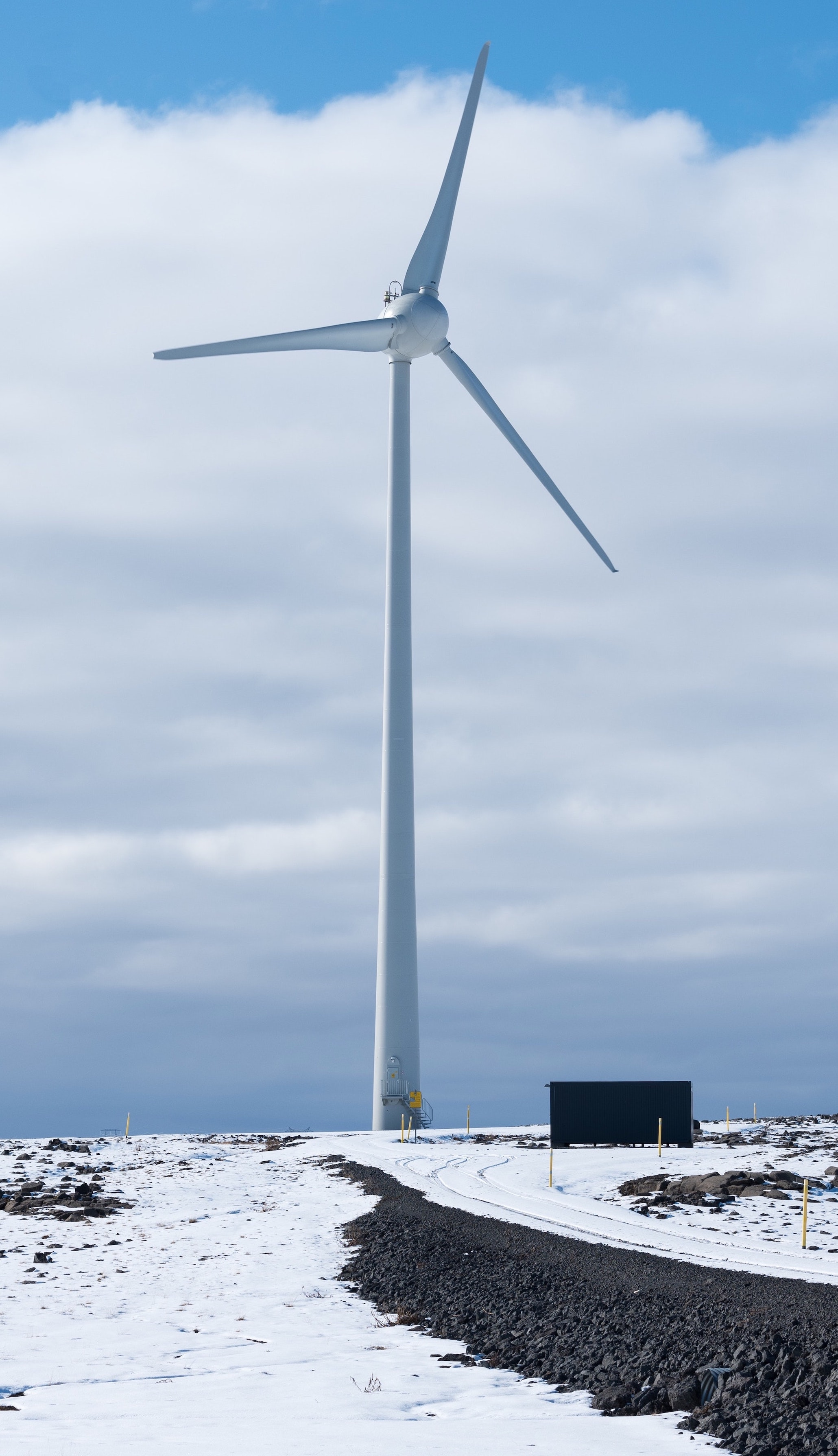 Picture of a wind turbine in a snowy landscape.