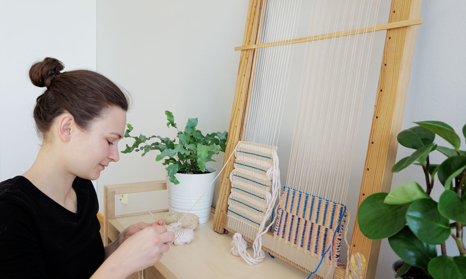 Portrait of Valentina Lachner, working on some weaving