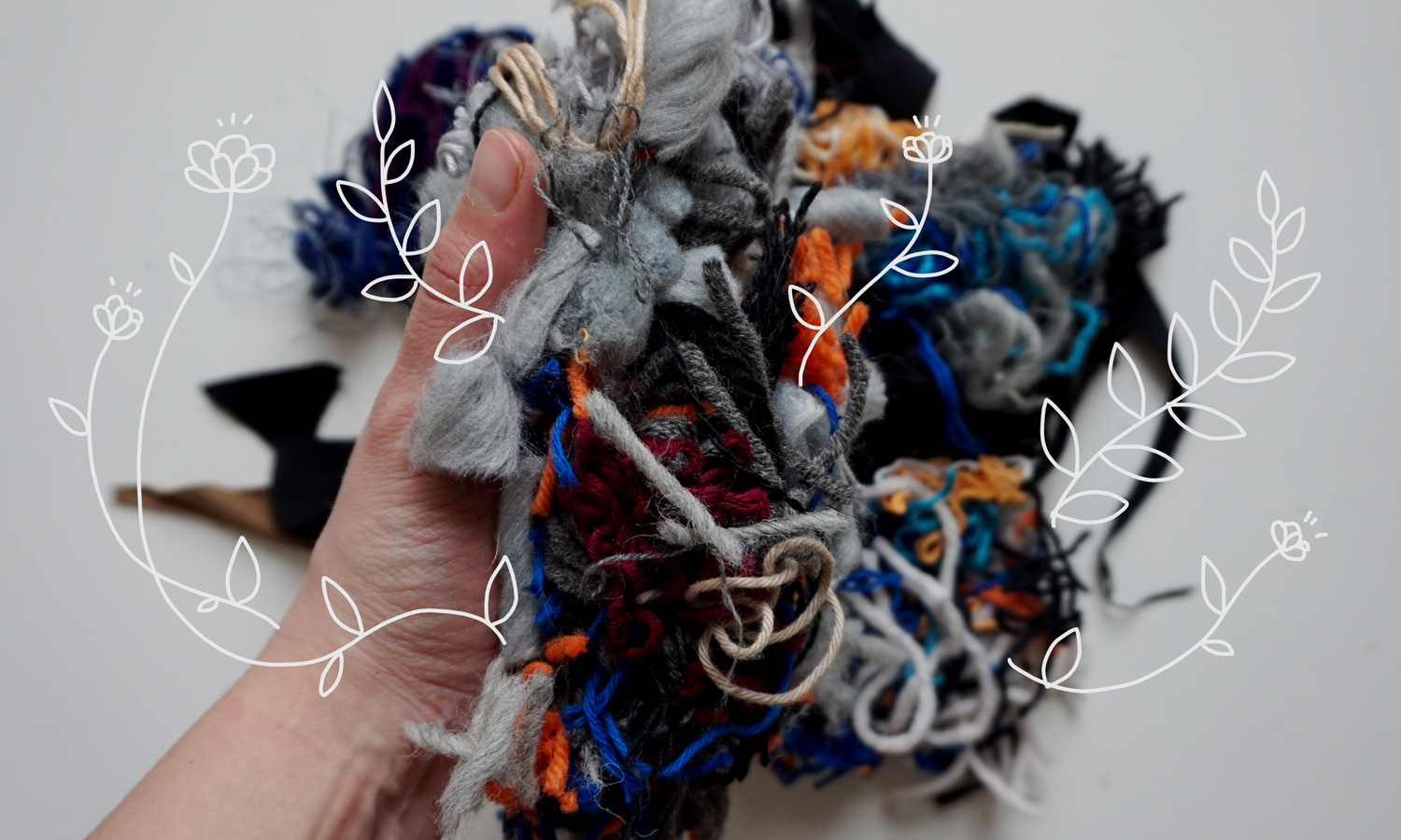 A pile of yarn and textile scraps with illustrated plants growing from it.