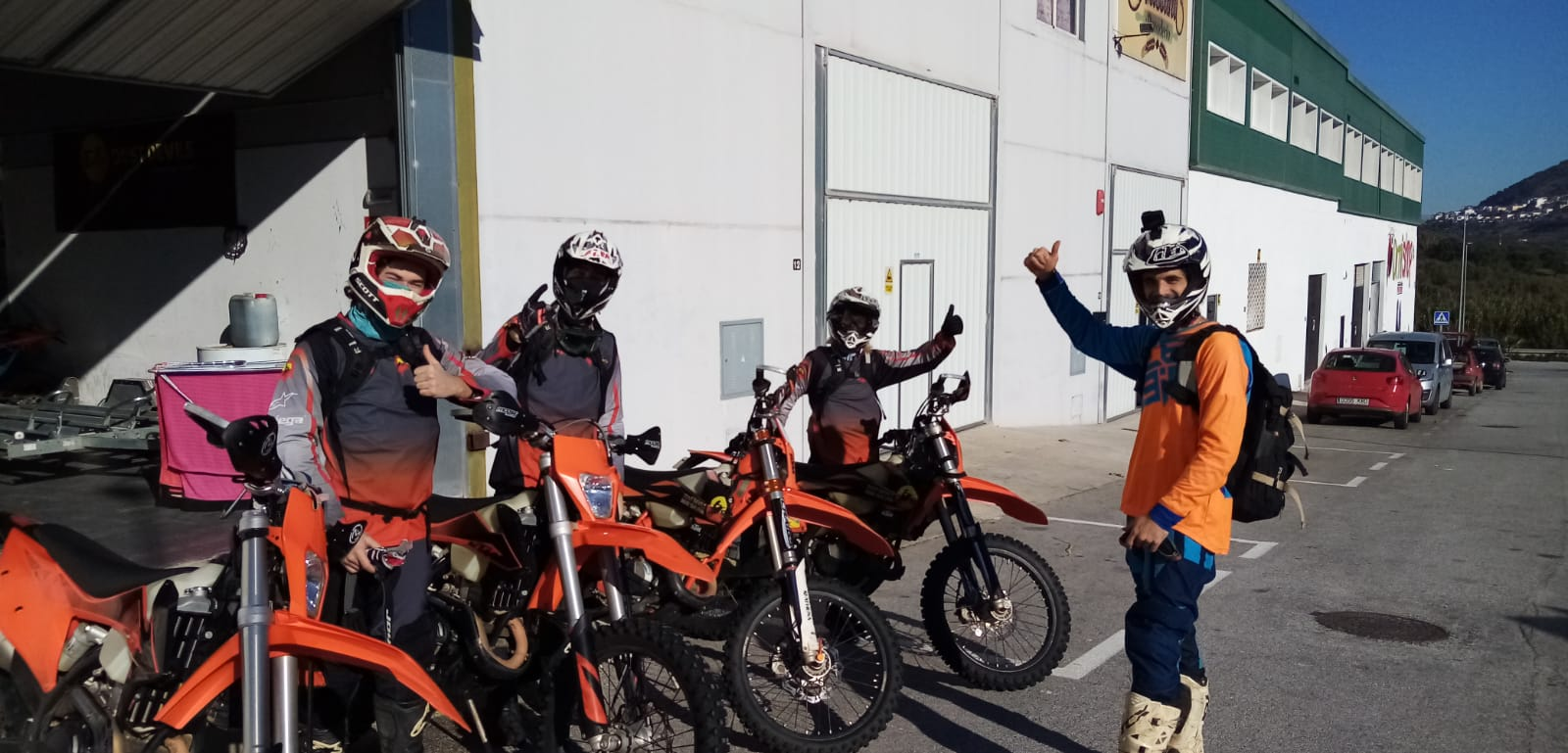 4 motorbike riders with thumbs up