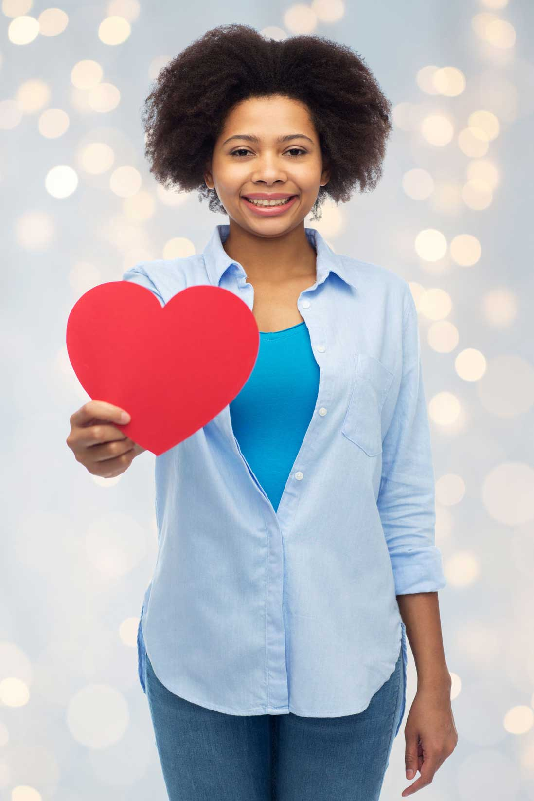 Image of a female employee holding a red paper heart