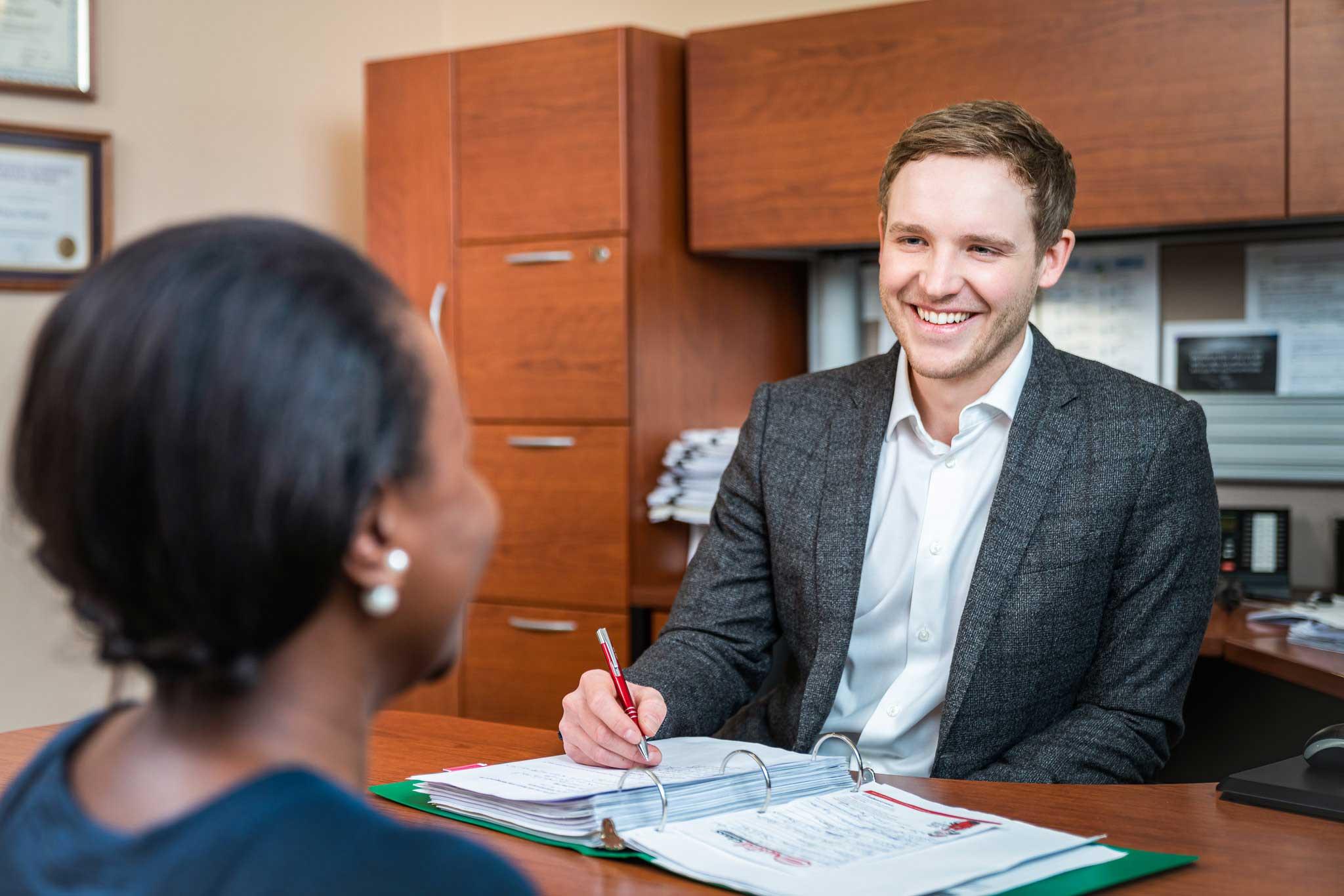 Dan Van Helden helps a client get insurance at Van Helden Agencies