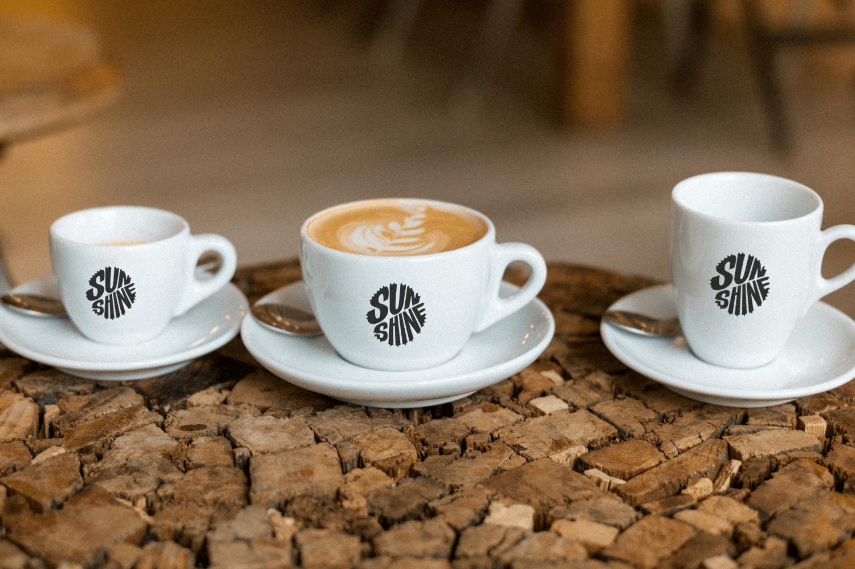 Sunshine Bike Logo auf Kaffeetassen