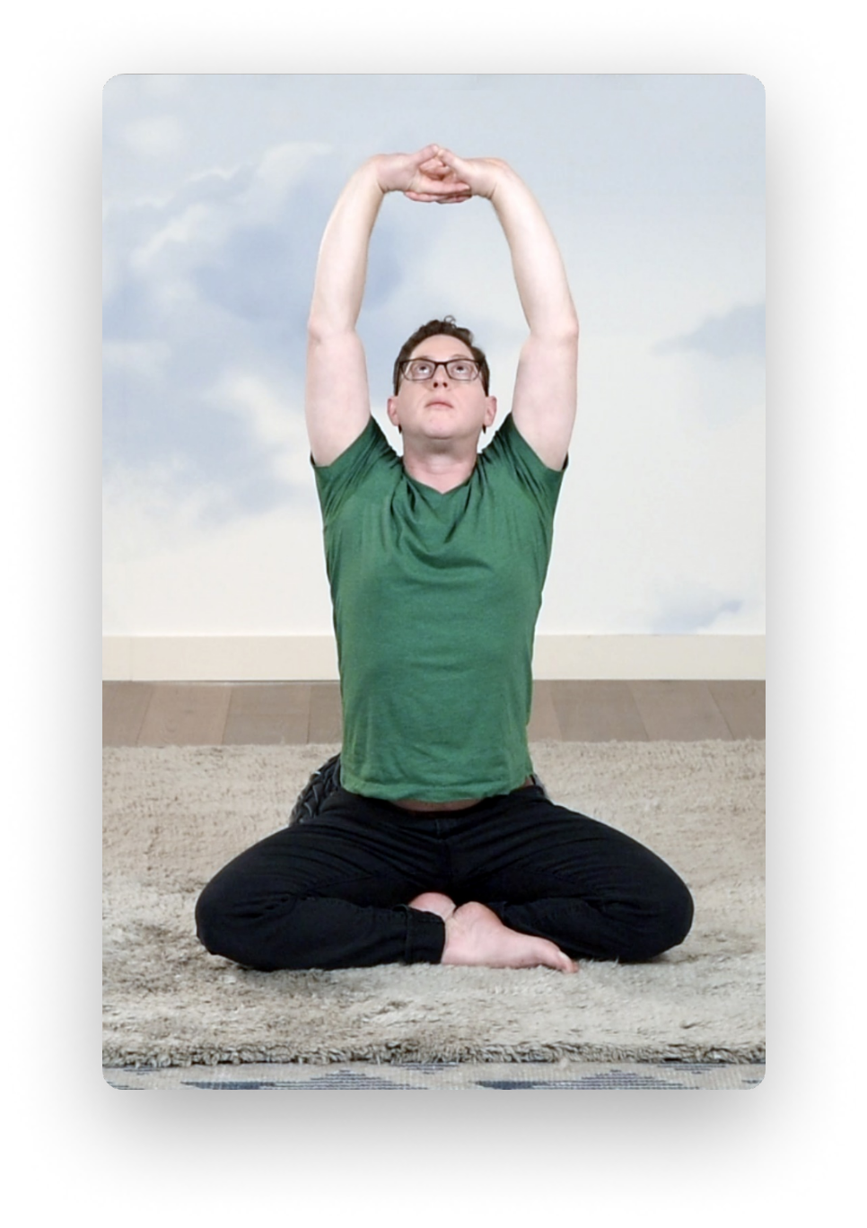 Photo of Adam Weinberg practicing Qi Gong exercises in the Sky Room at the Assemblage Park Ave South.