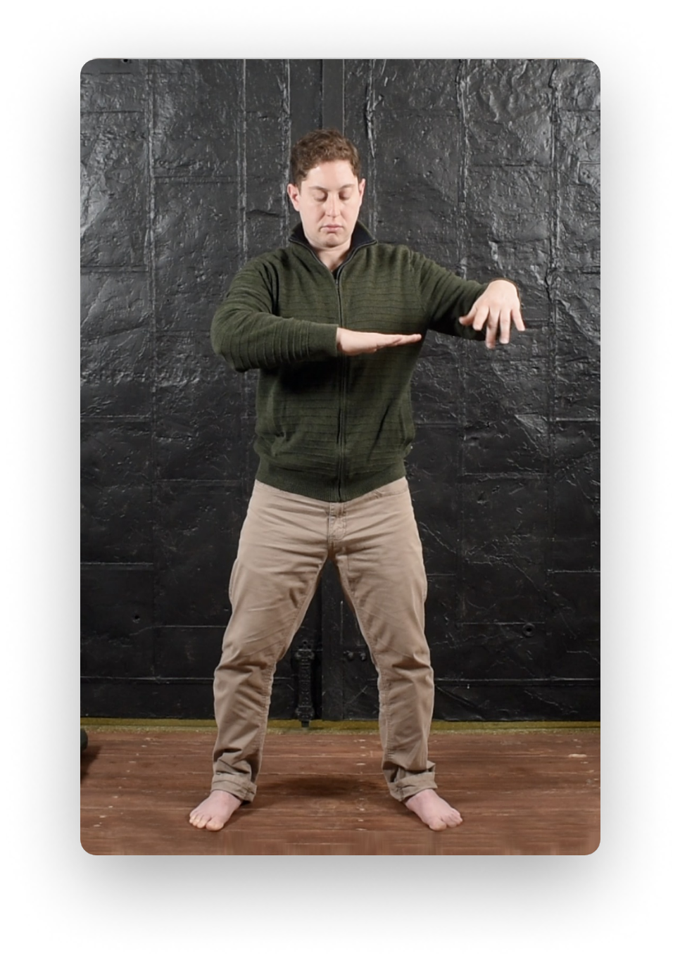 Photo of Adam Weinberg practicing Qi Gong exercises.