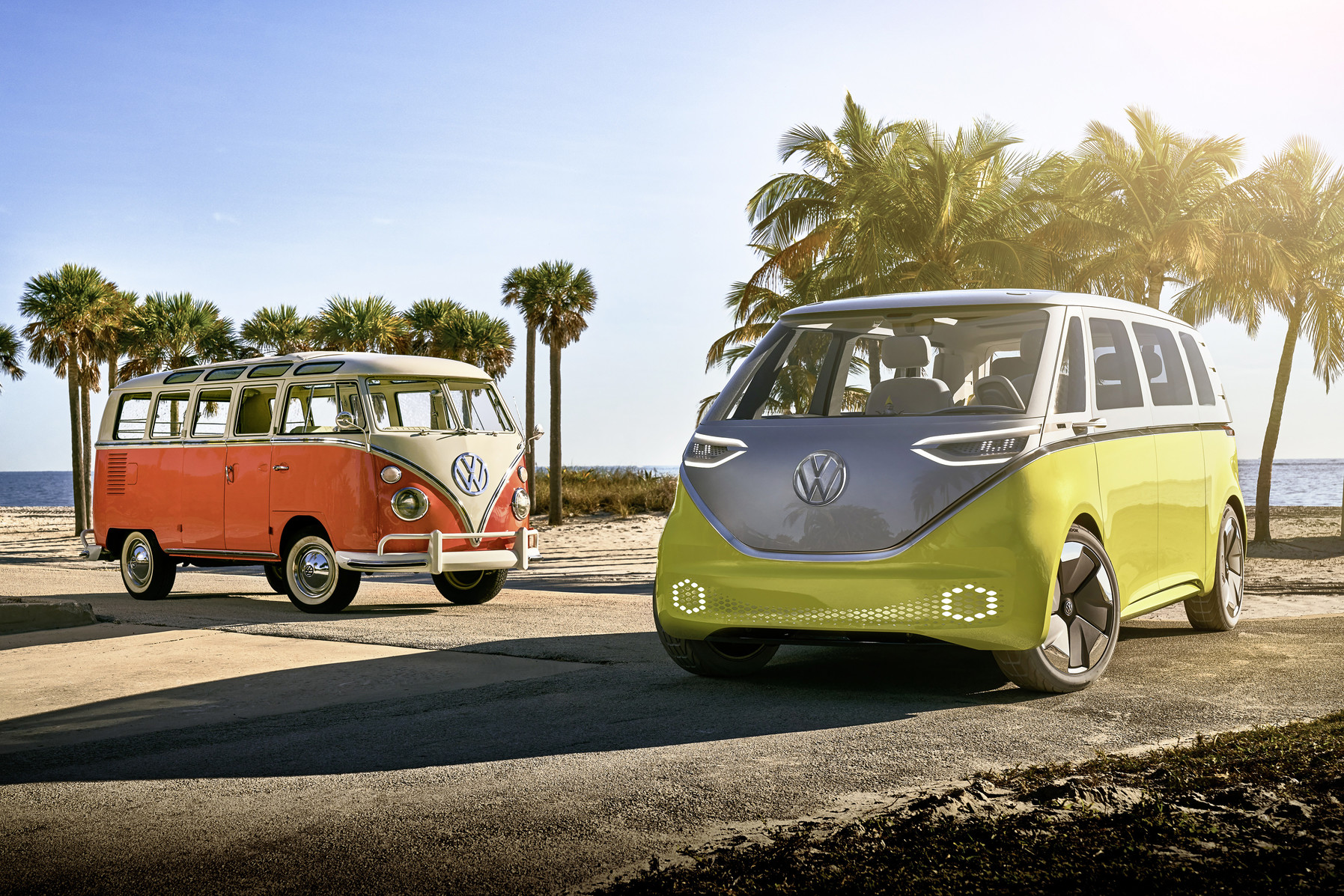 Old VW Bus and New Electric VW Buzz at the beach