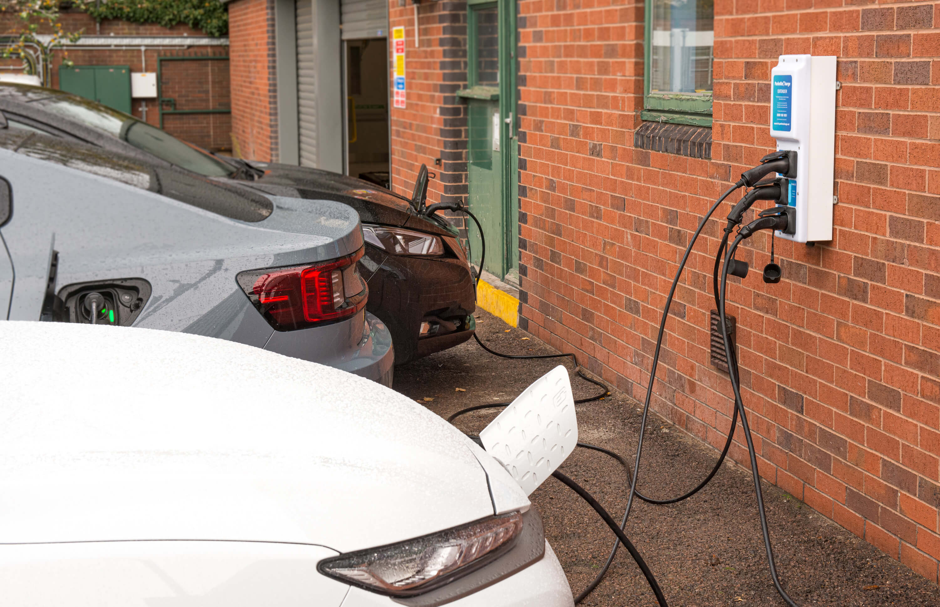 Three Electric Cars charging from one Charger