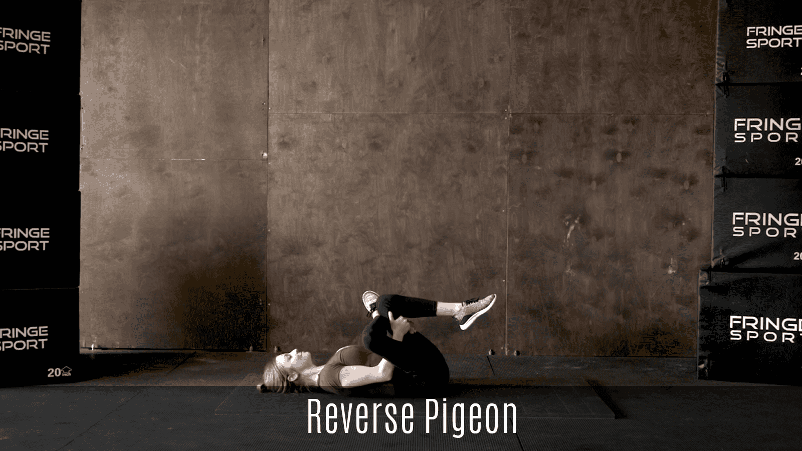 reverse pigeon stretch demo lying on floor