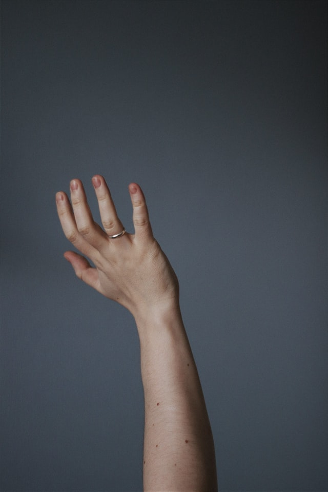 Wrist being extended with a neutral background