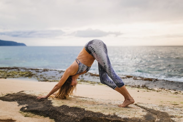 Woman doing yoga in a rocky area