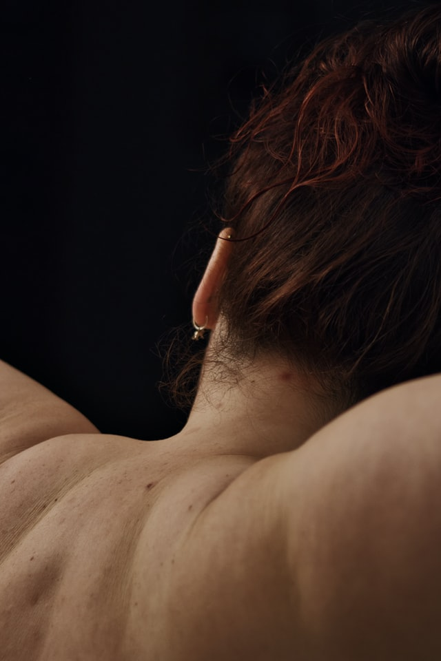 Woman extending her shoulders from behind