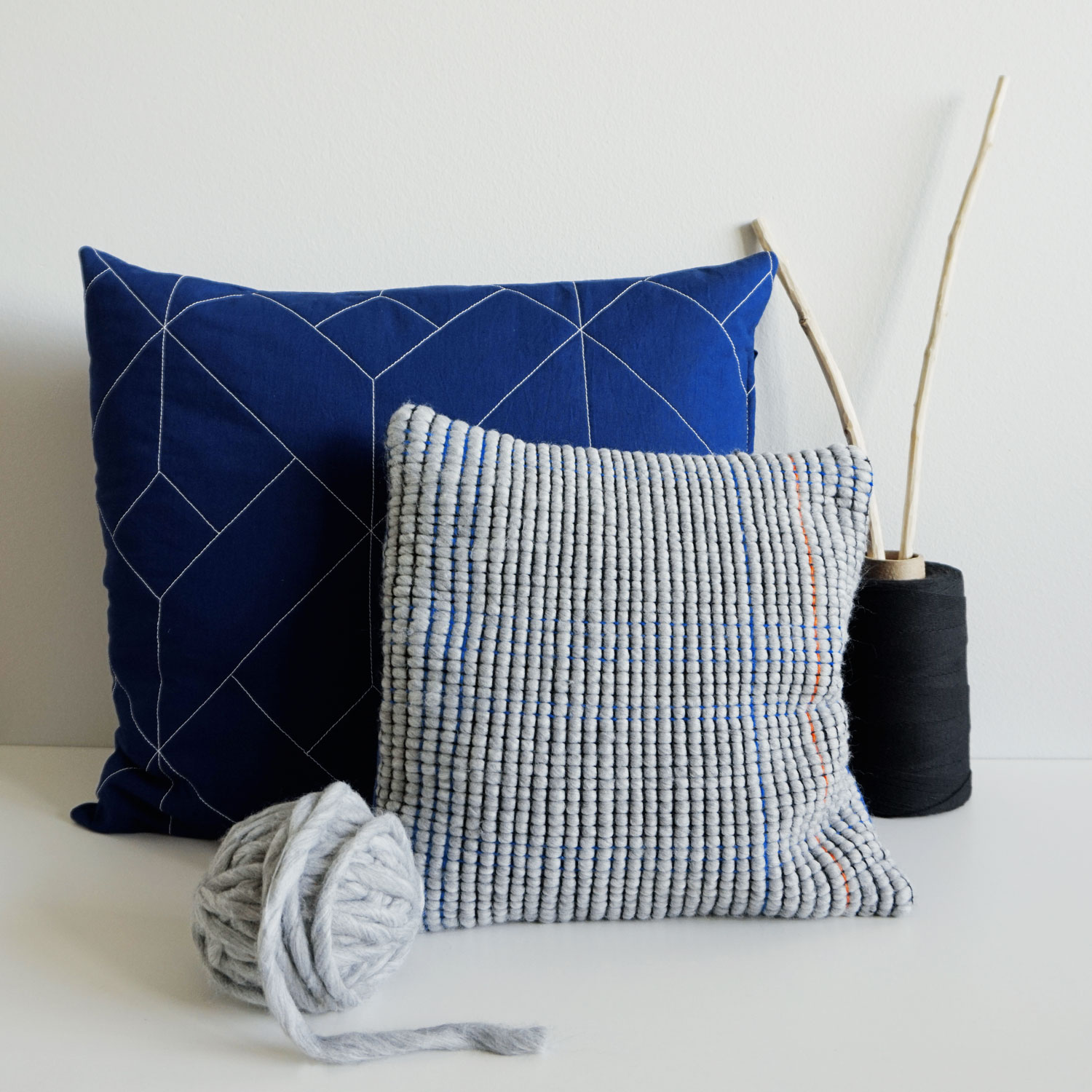Extra large quilted pillow case with a subtle line graphic pattern. Cobalt blue recycled fabric and a simple envelope closure system.