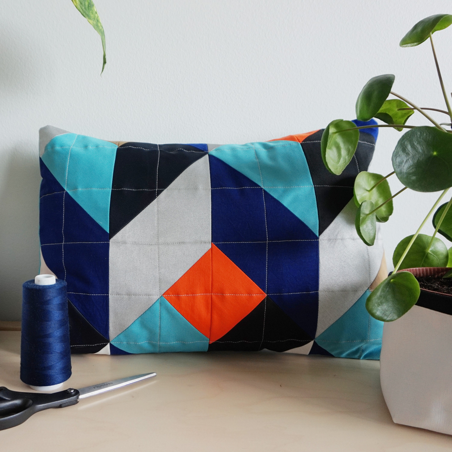 A bold geometric quilted pillow case, featuring a mind-bending 3D-pattern of stacking cubes.