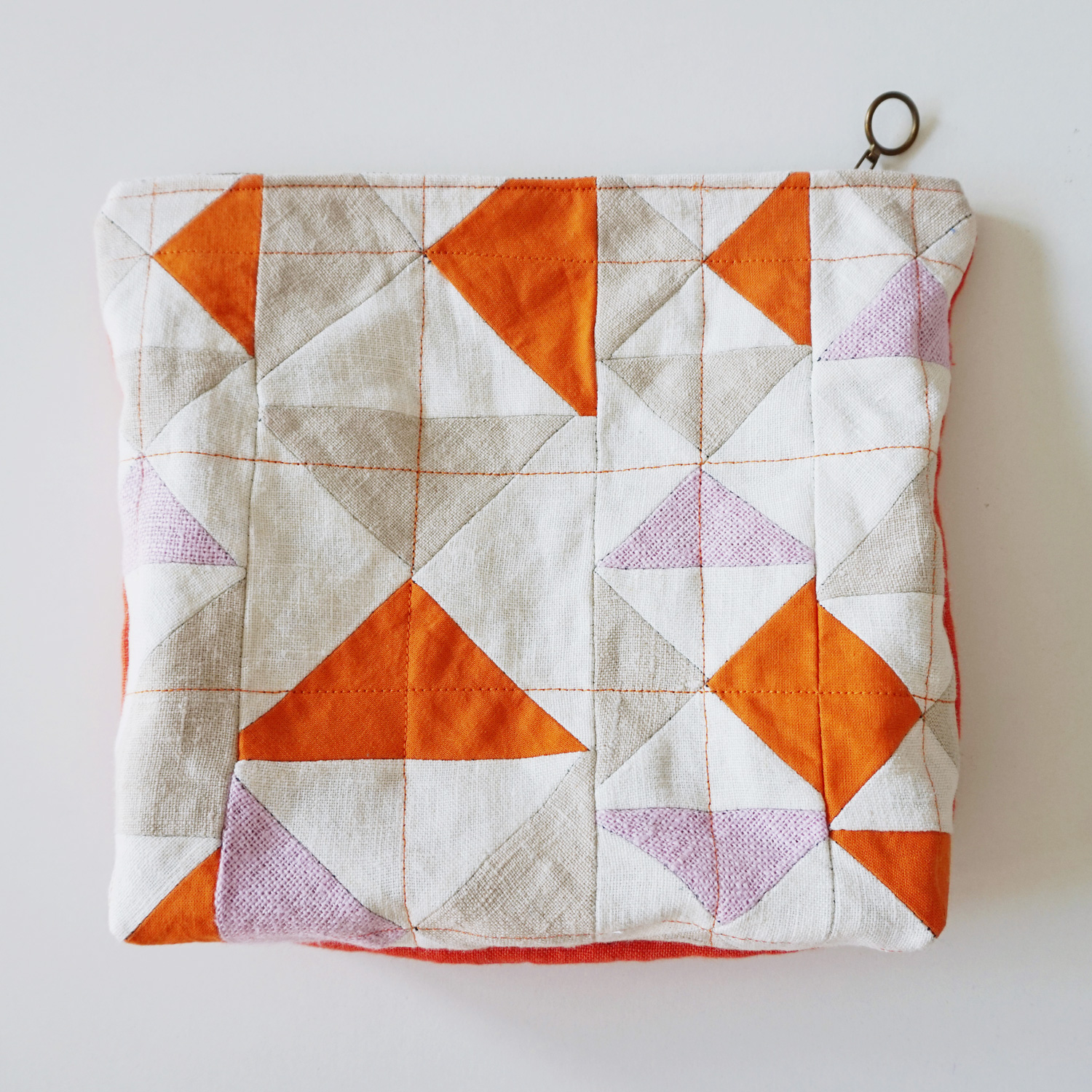 A fresh and bright little zipper pouch for storing your current knitting project, collection of pens or travel essentials.