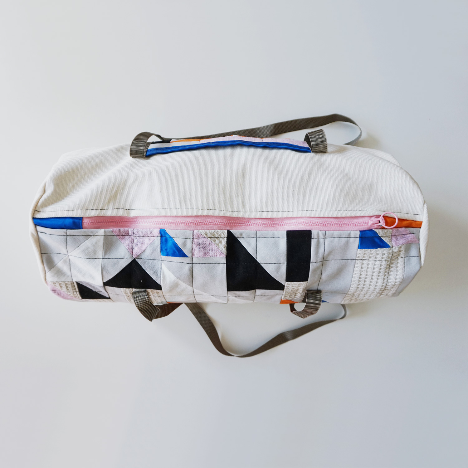 A geometric and sturdy duffle bag that fits all your workout gear or weekend essentials.