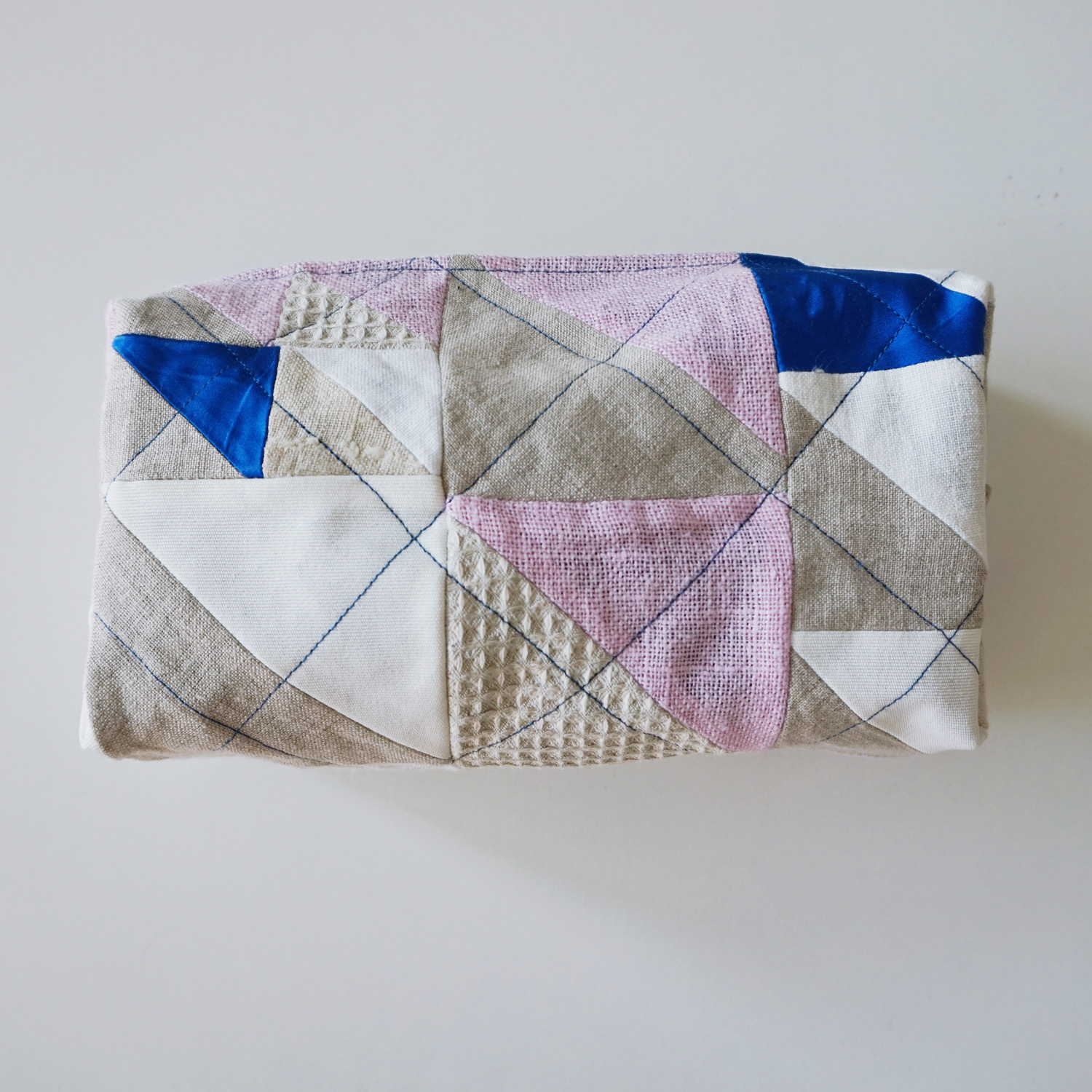 A handy quilted boxed pouch, that will hold your essential travel toiletries or extensive pen collection.