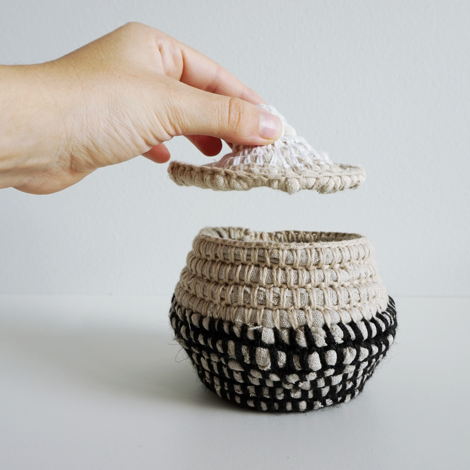 An assortment of color blocked crocheted baskets to use as storage for your yarns, as planters or textured decor elements.