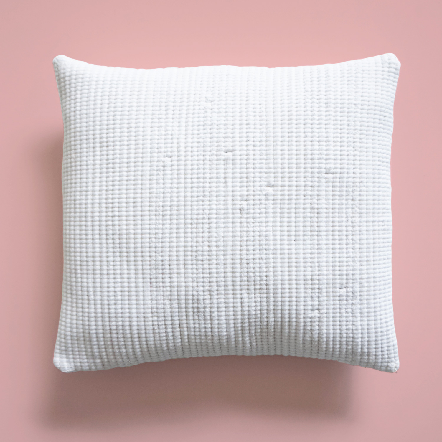 Soft, textured white accent pillows to subtly spice up your sofa or armchair. Comes in a classic square or funky cylindrical shape.