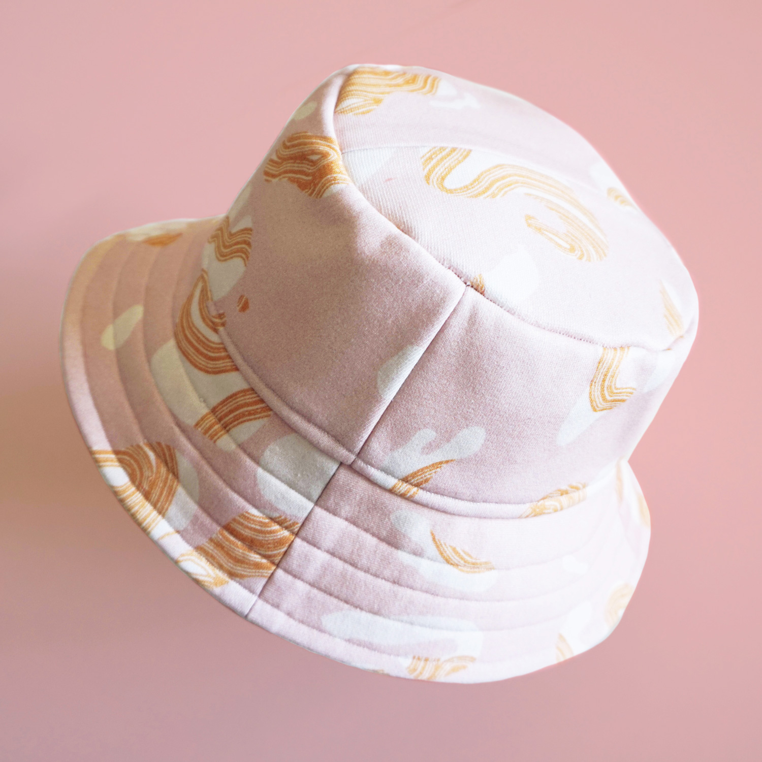A fun swirly patterned bucket hat that will protect you from the sun in a stylish way.