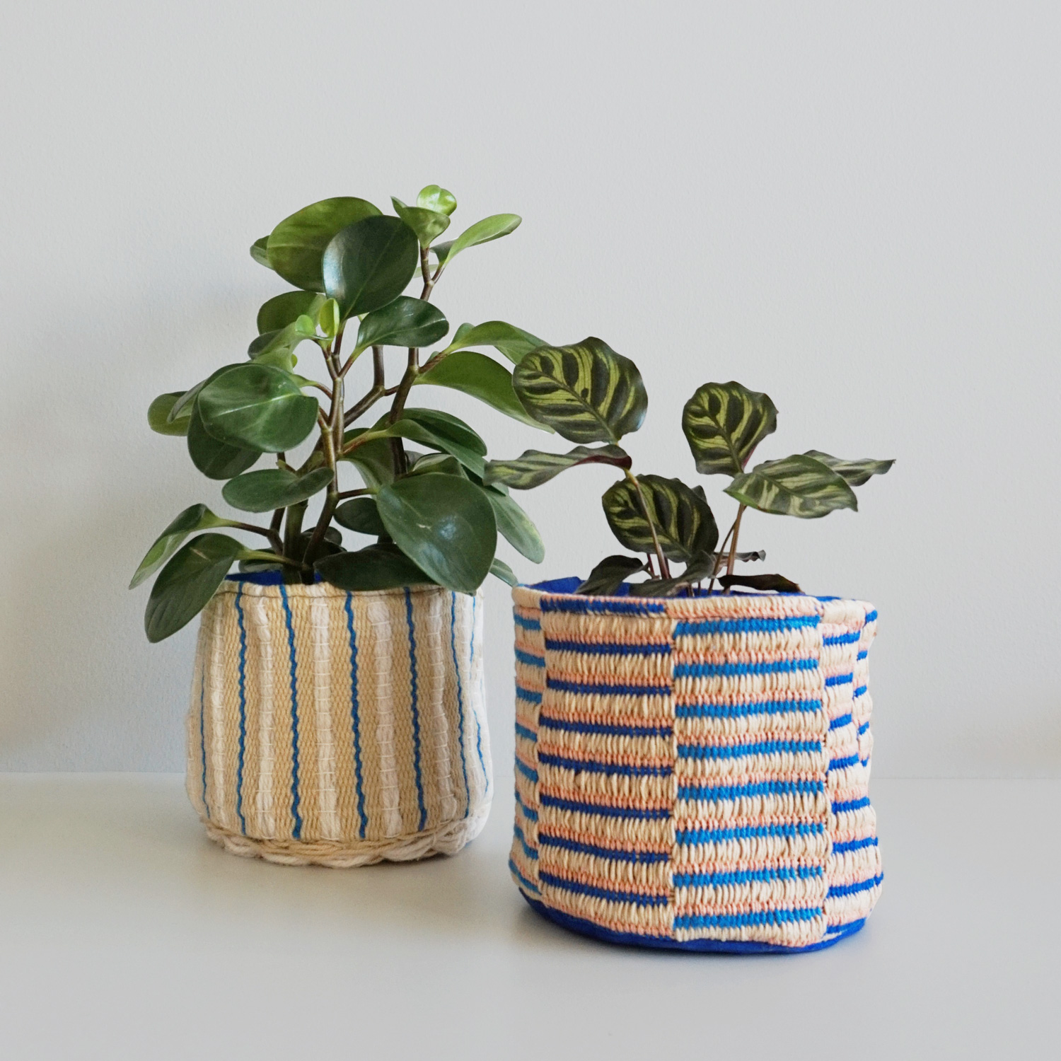 Small striped baskets with a woven texture make the perfect home for your favorite plants, current knitting project or washi tape collection.