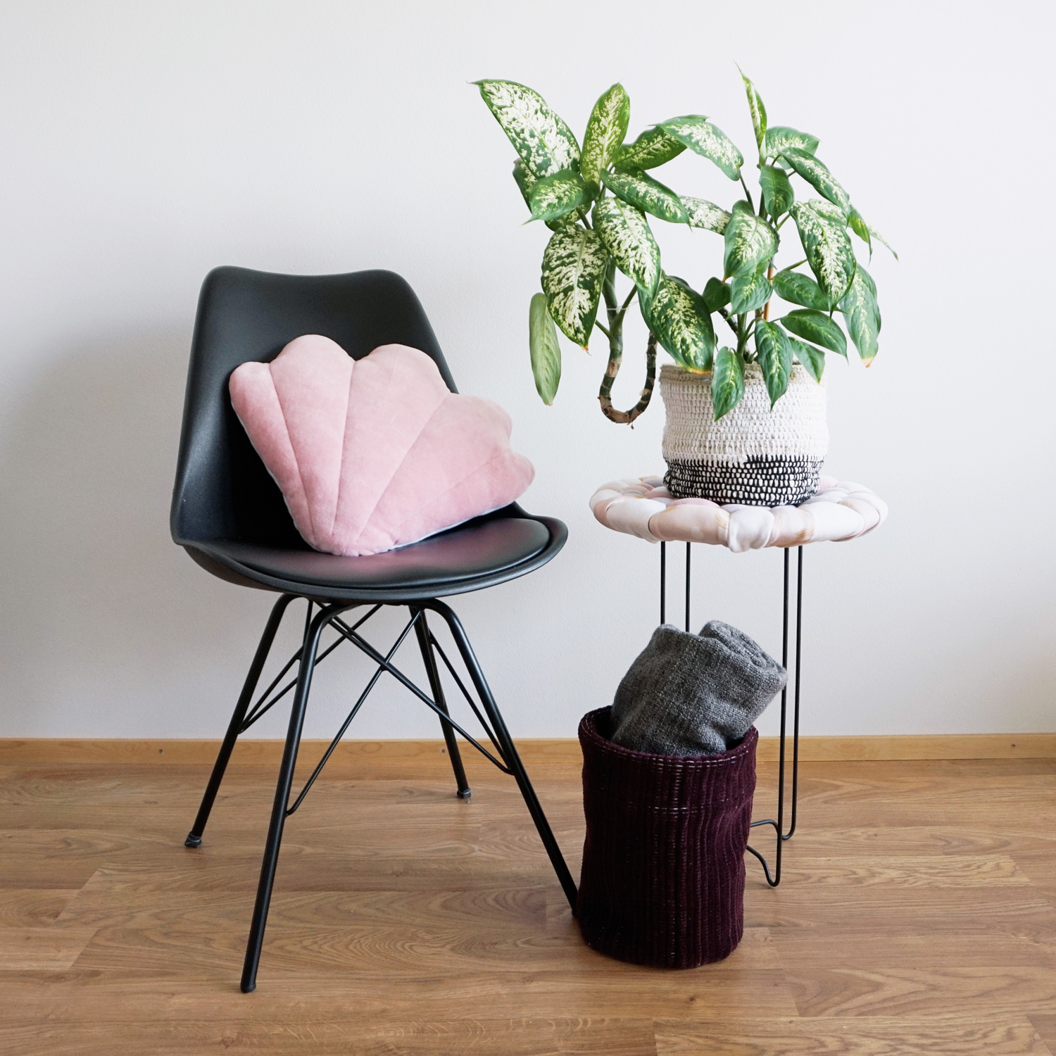 A quirky soft textured side table with a stone pebble-like surface. Perfect as a plant stand or to keep a stack of books next to your sofa or bed.