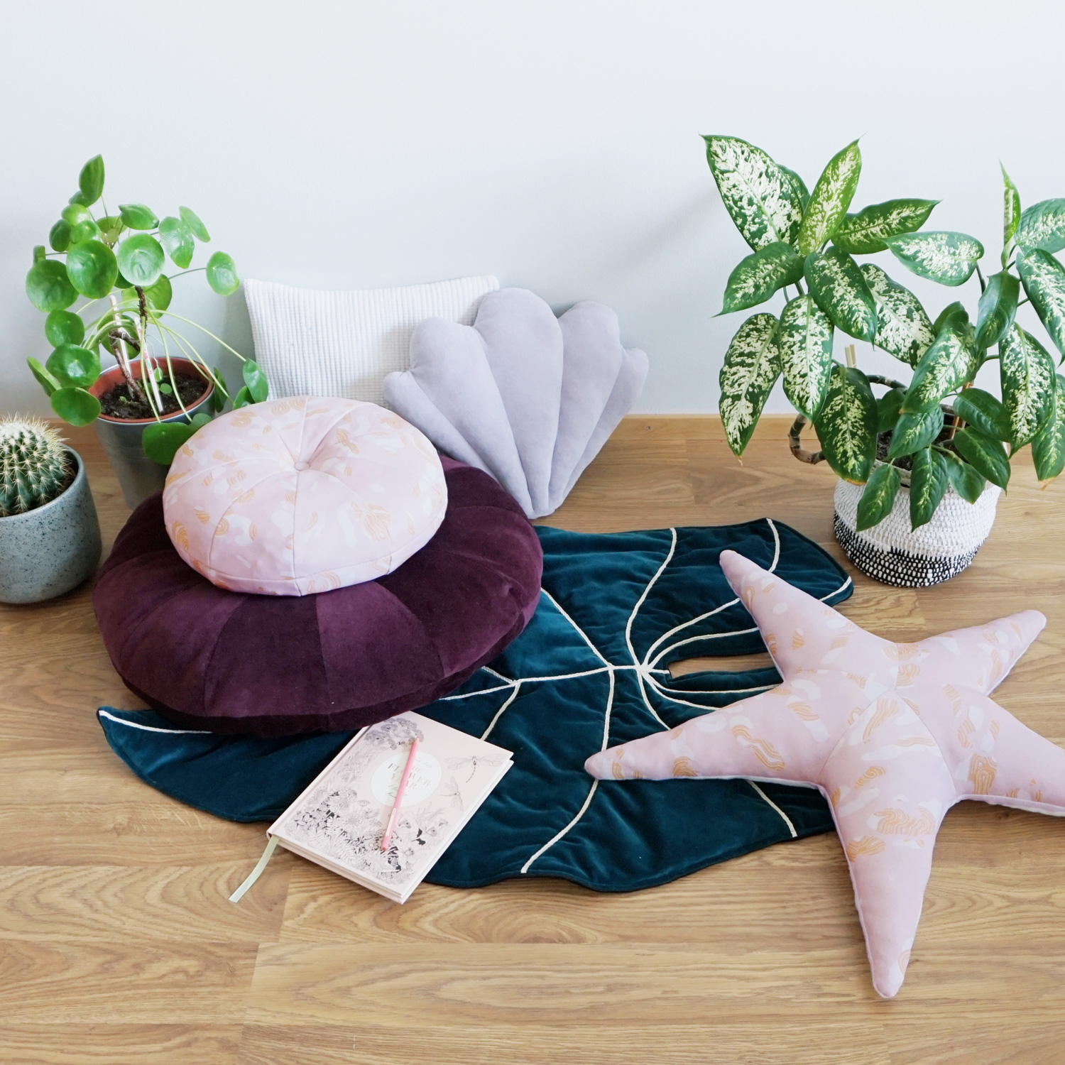 A small and large circular pillow with a button accent to use on the floor or as an accent pillow.
