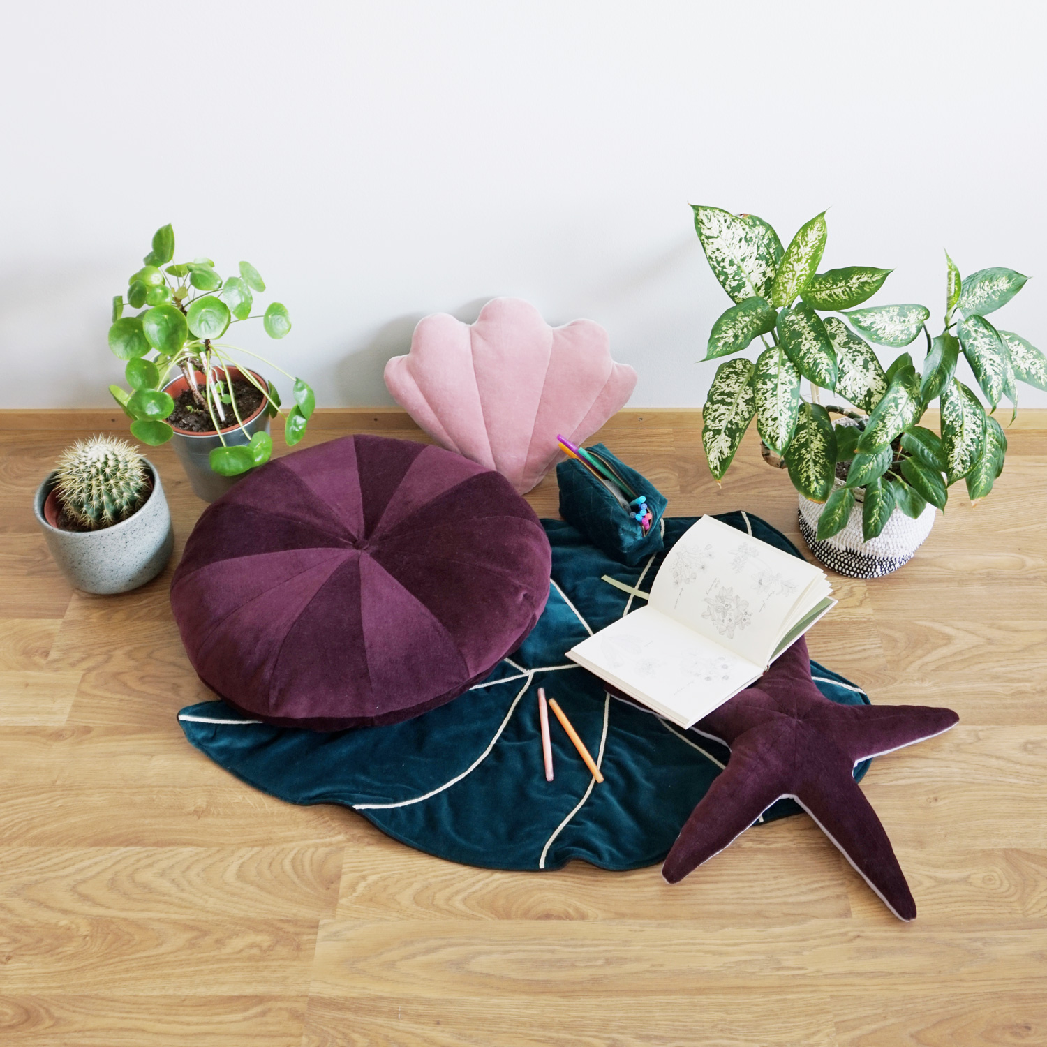 A squishy starfish shaped pillow, bringing a touch of the wild blue ocean into your home or kid's room.